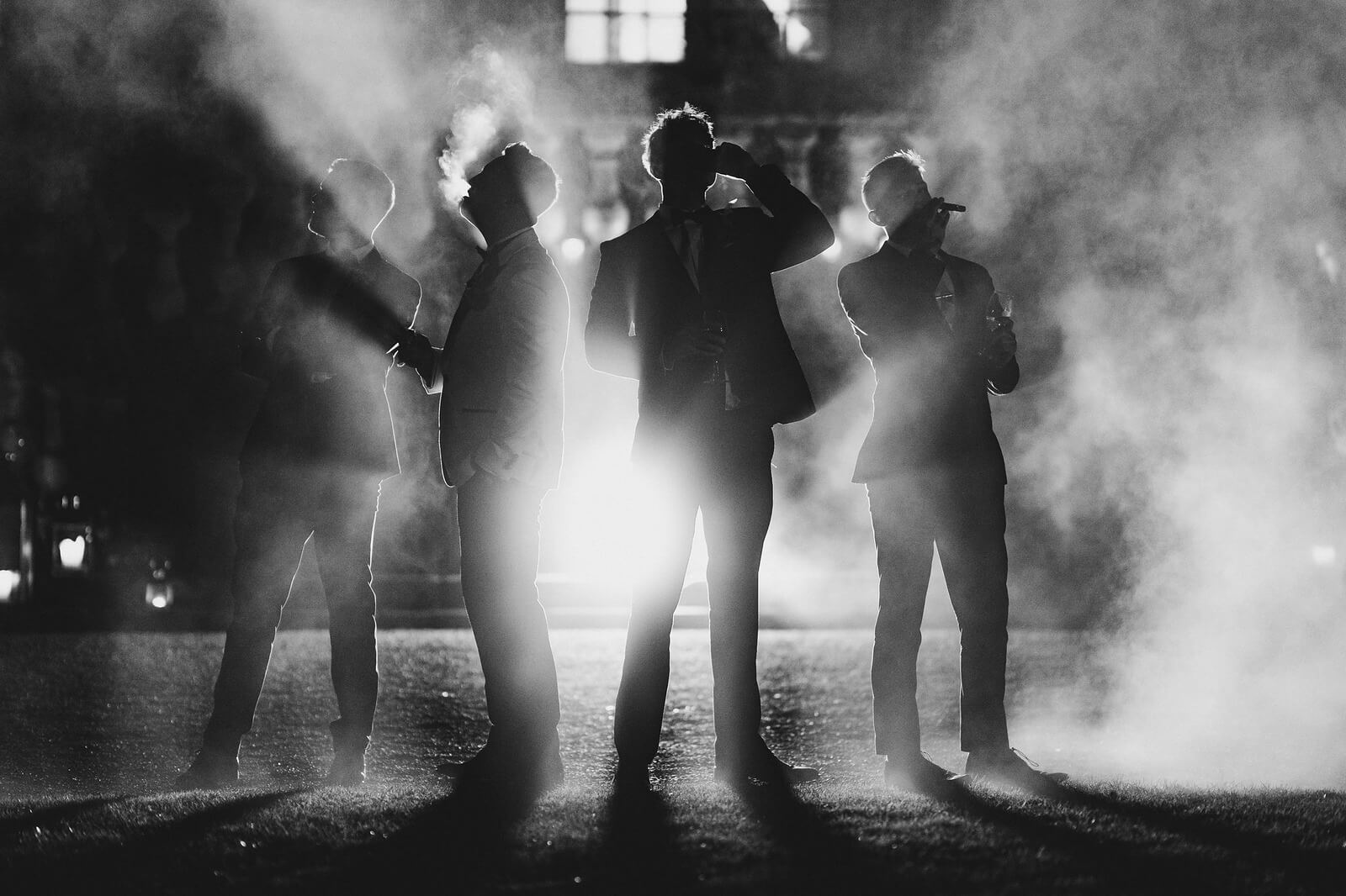 Black and white photo of groomsmen drinking with smoke effect - perfect photos