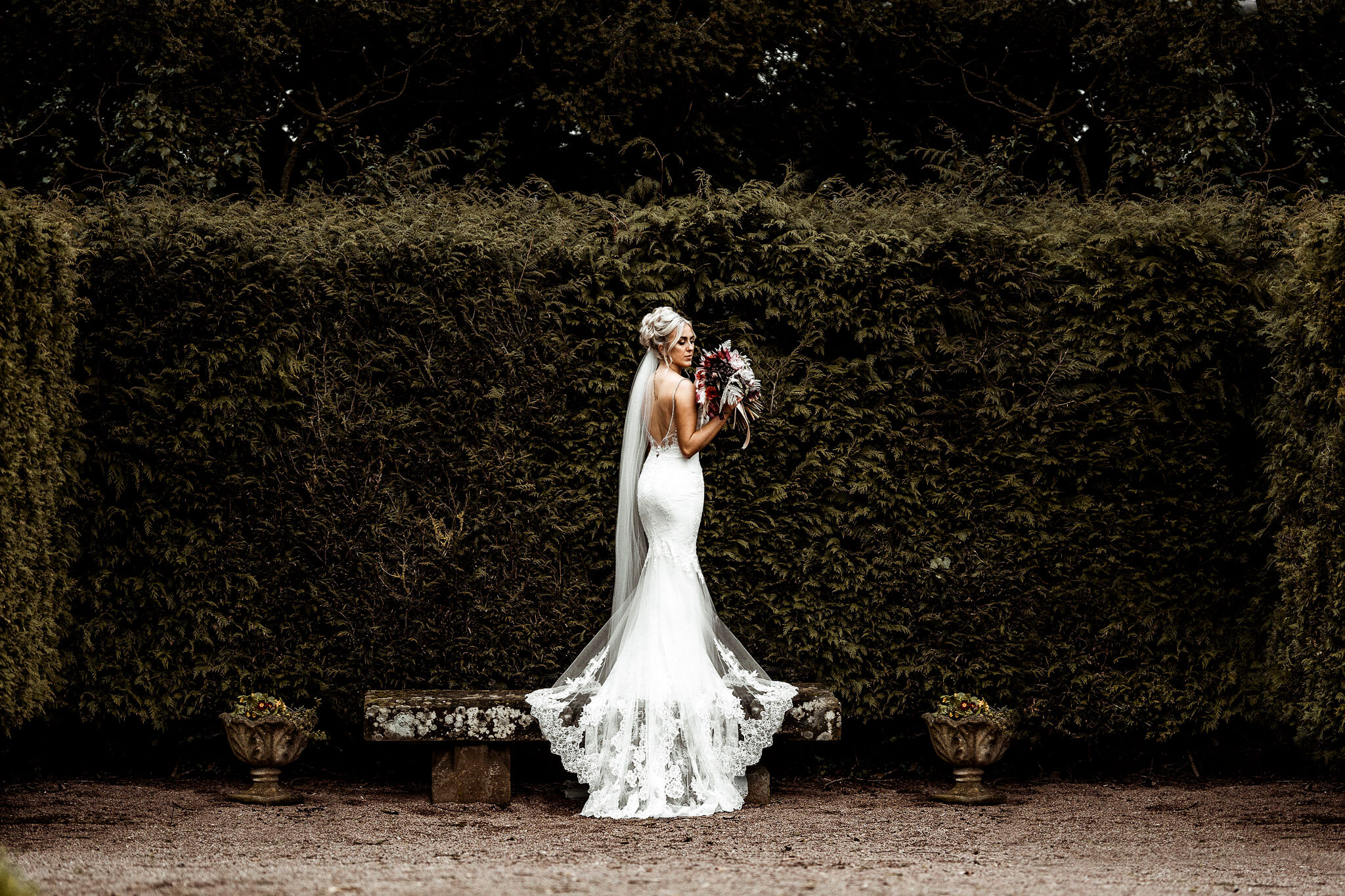 Photo taken of the back of the bride as the bride looks back into the camera - special moments