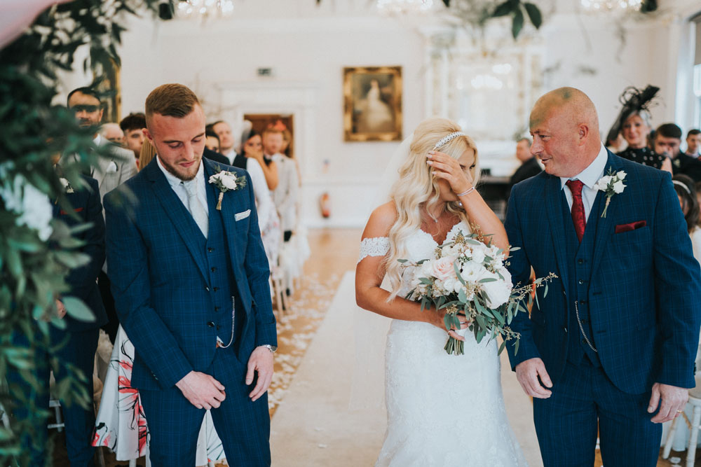 tears fall as bride meets her partner at the end of the aisle