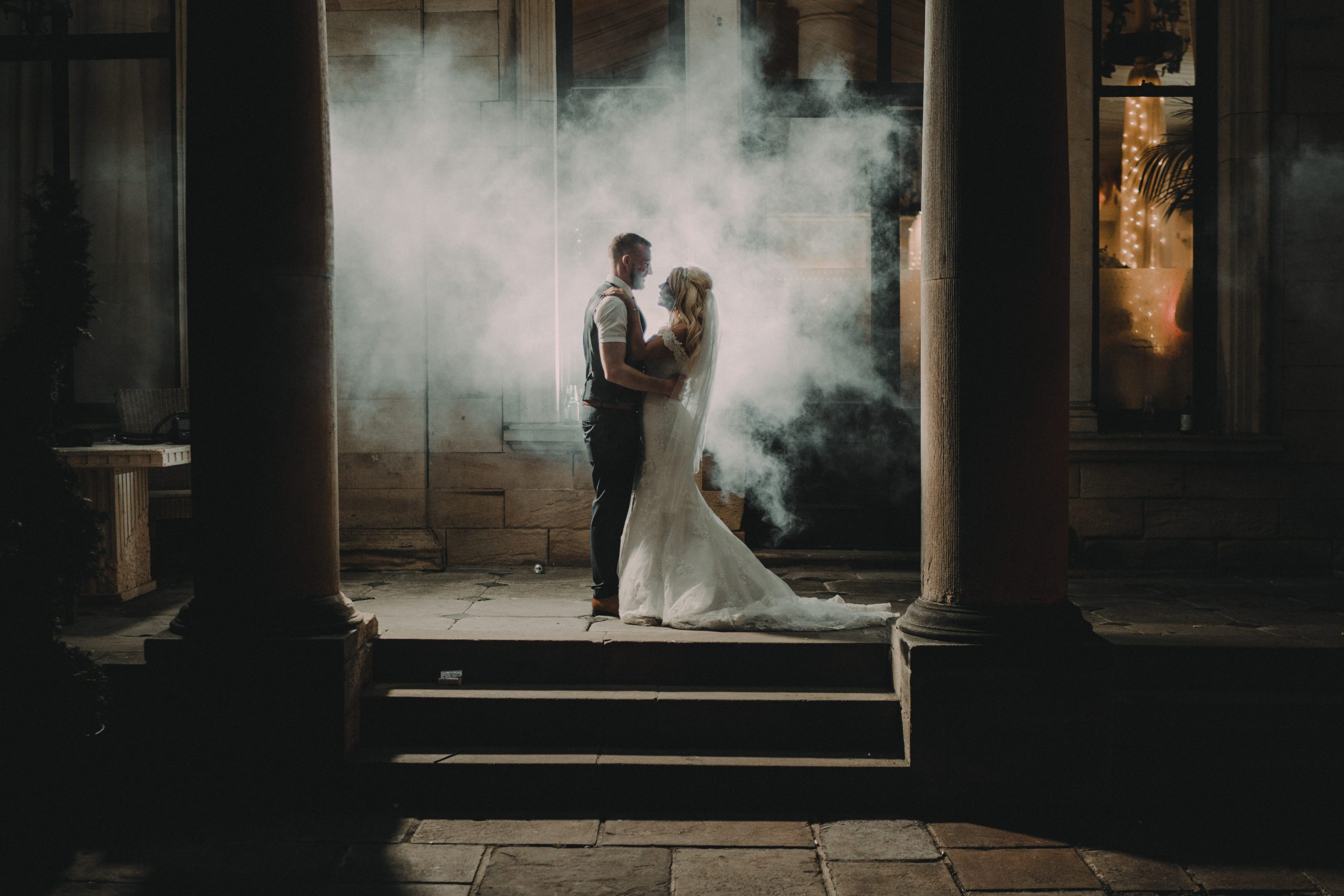 the couple hold each other in smoke