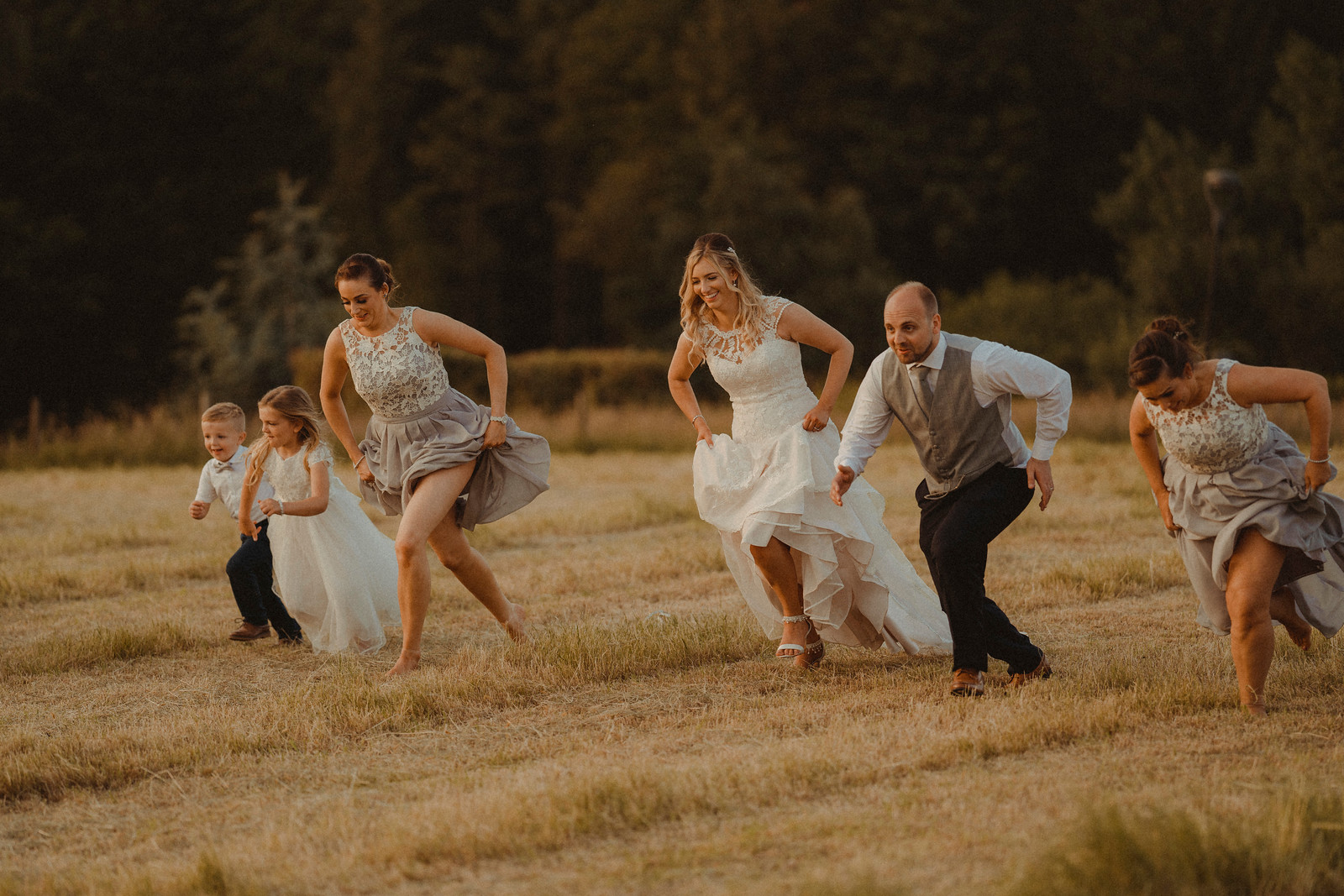 Family photo of everyone running through the country fields