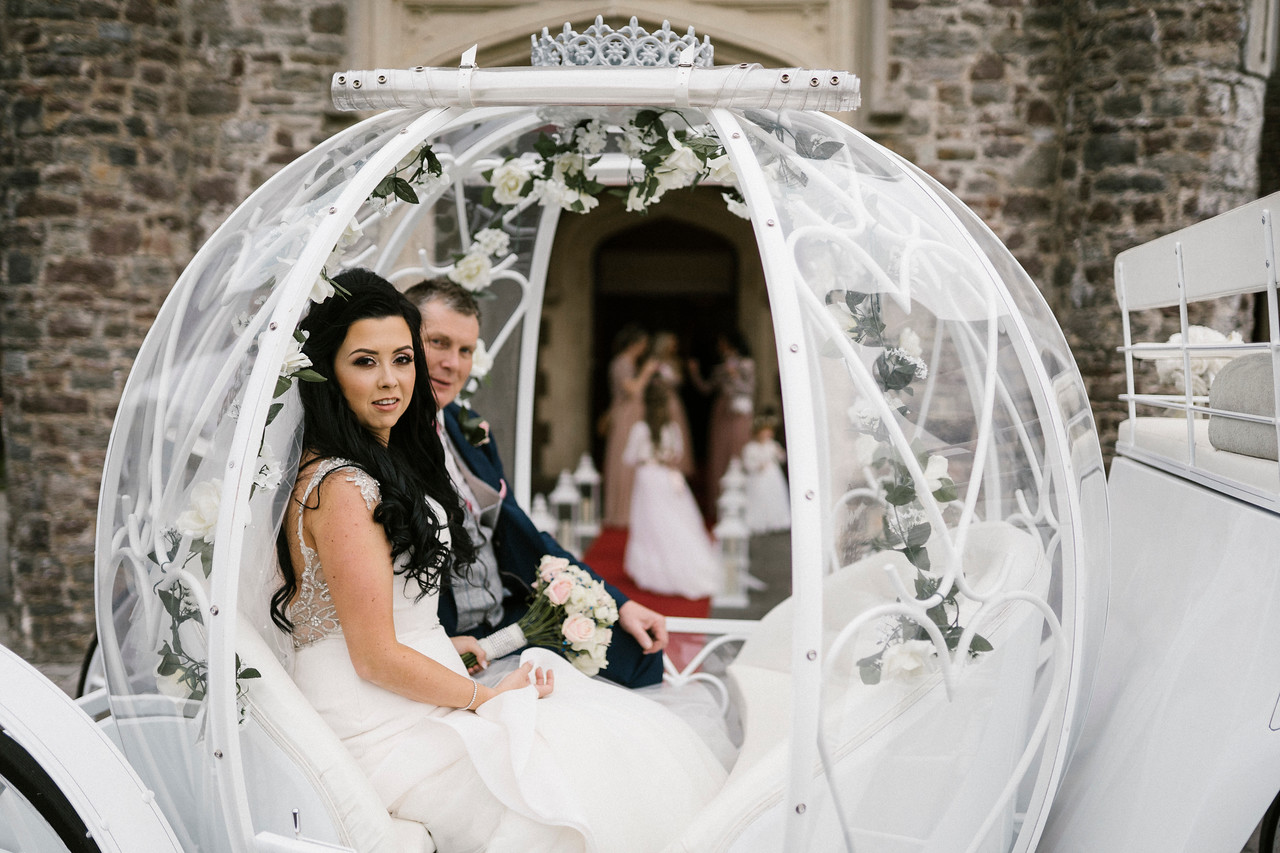 bride and groom in horse and cart