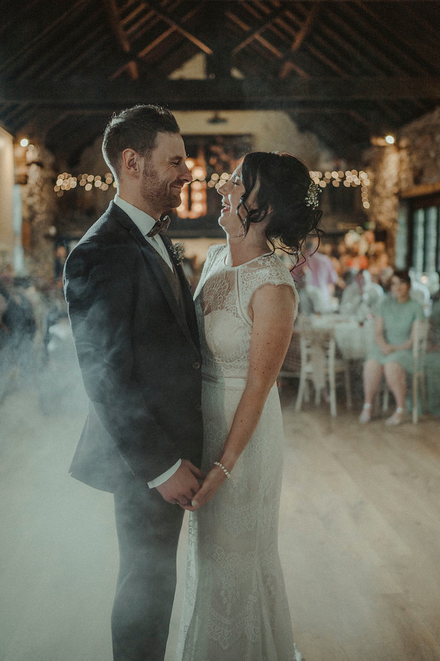 Bride and groom have their first dance in front of their loved ones