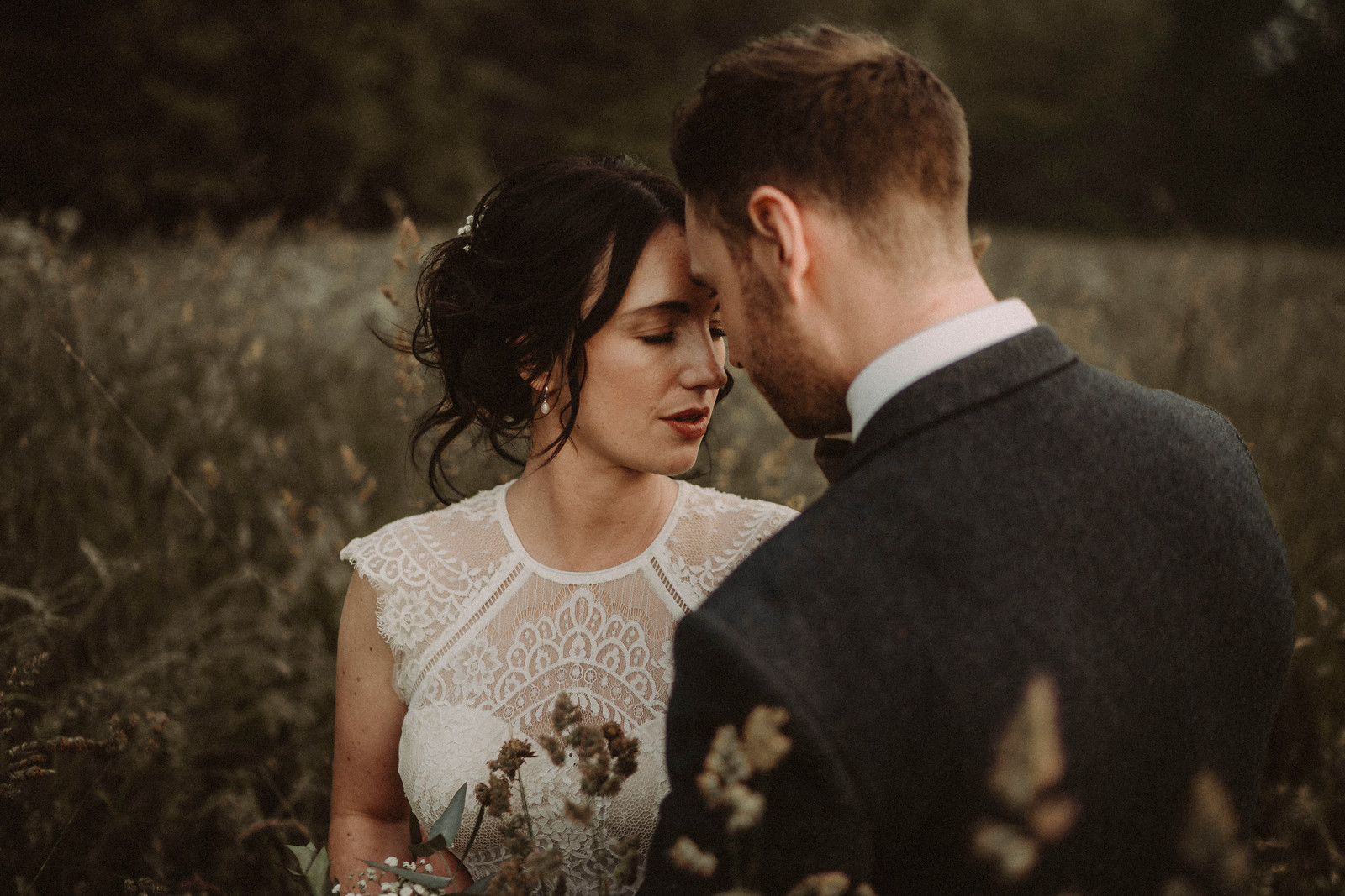 Bride and groom connect in the beauty of the countryside