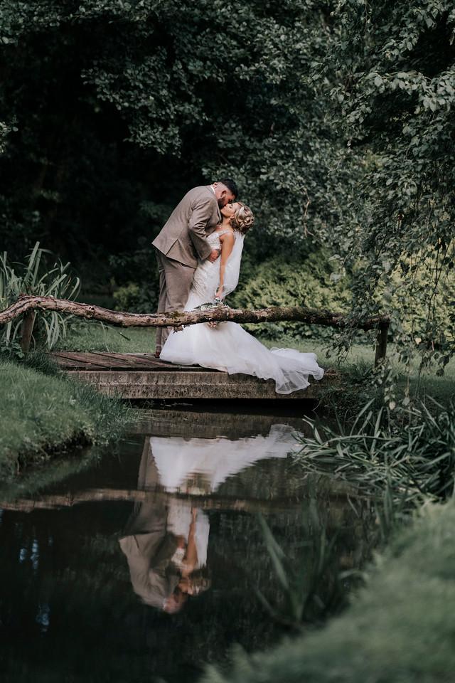 couple wedding photos by lake