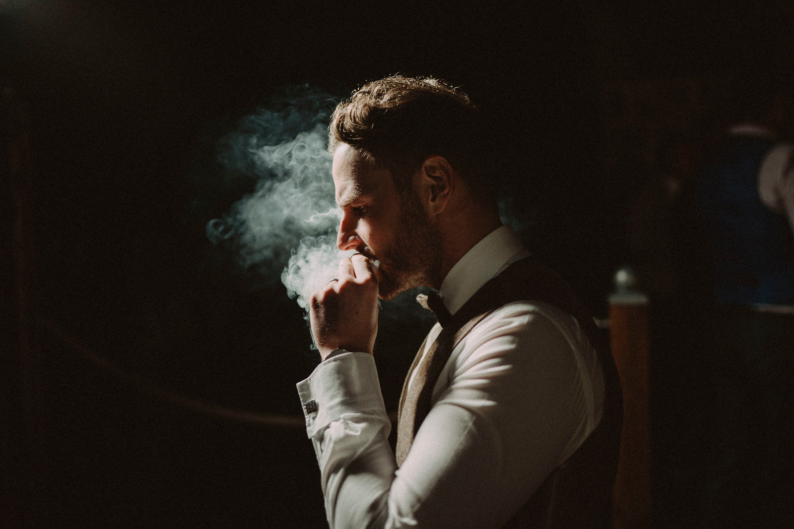 The rustic style is reflected through the groom smoking a cigar