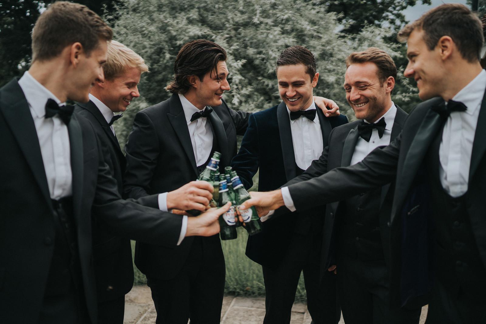 the groomsmen cheers to getting married