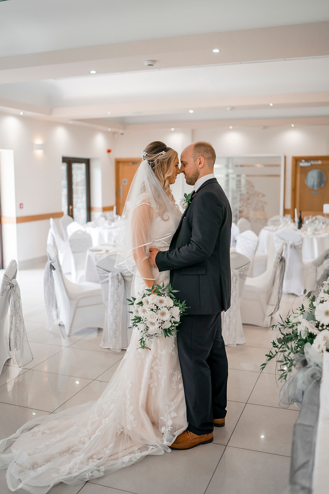 Bride and groom looking to each other eyes in the reception.