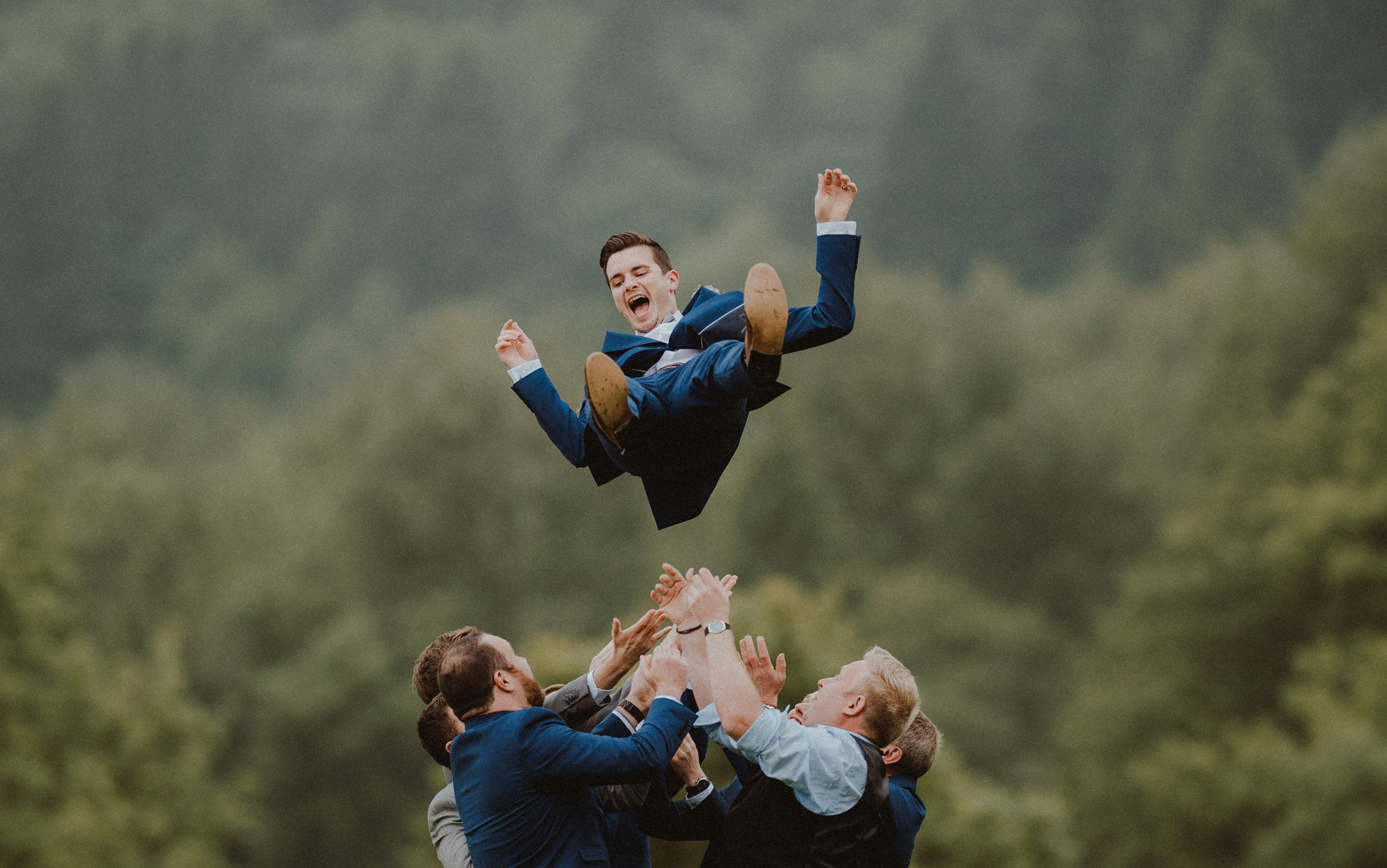 The groomsmen throwing the groom into the air| Smiles and full of laughter| Fun Wedding moments