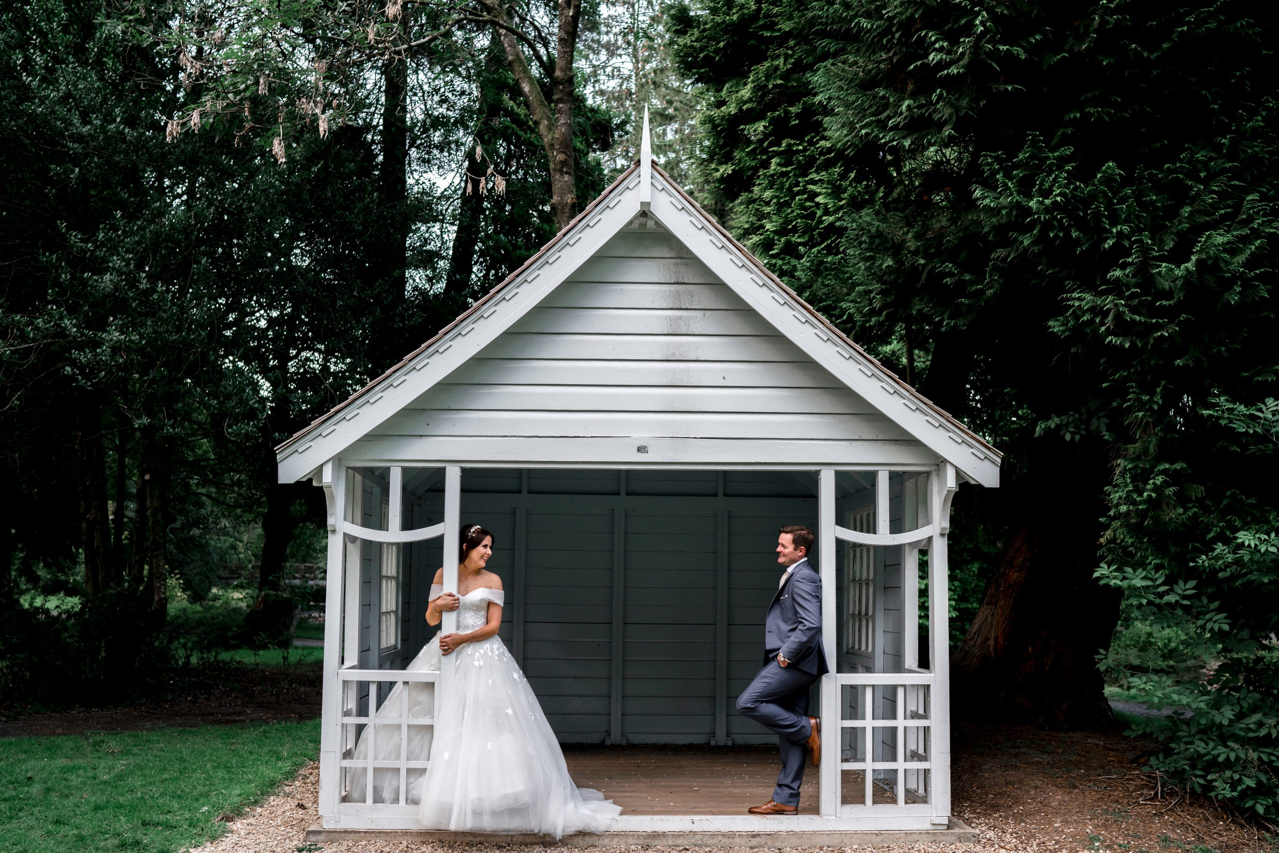 Bride and groom in a cabin look at each other