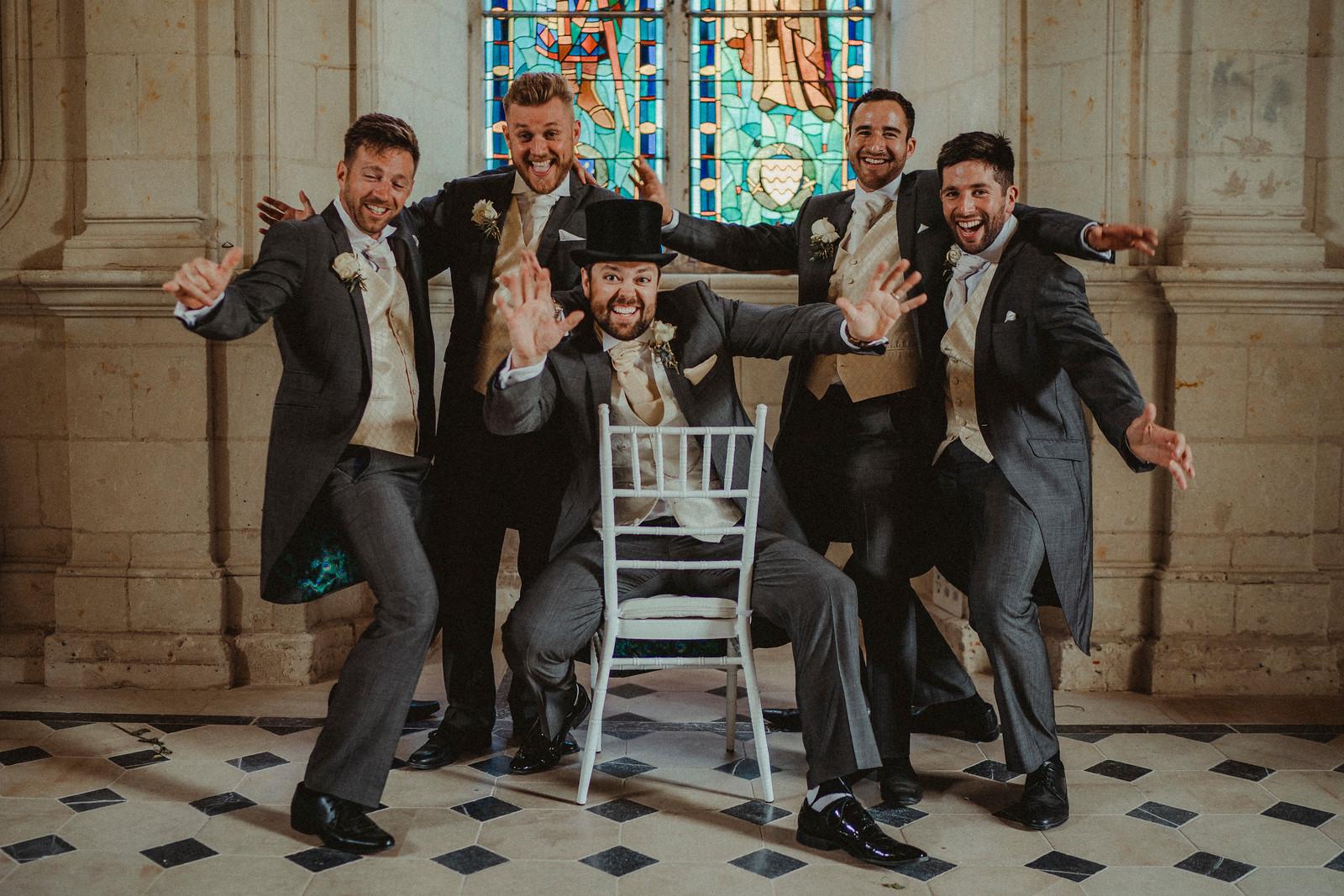 Fun groom photo with his groomsmen