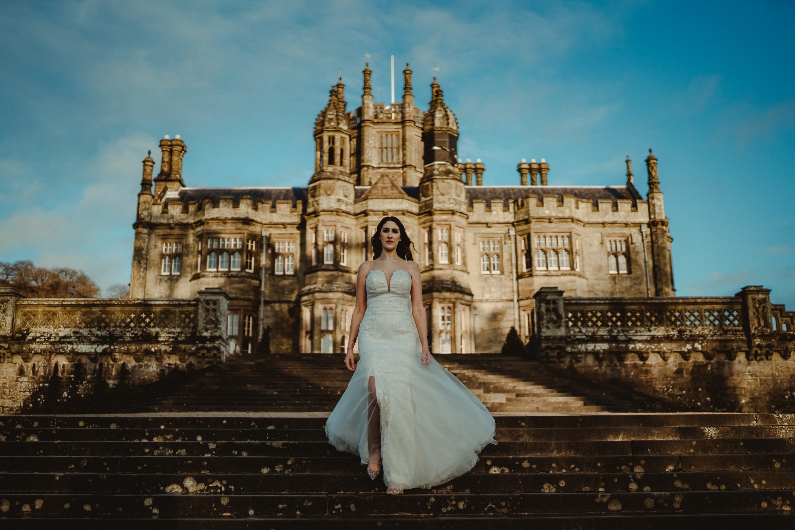 The bride walks away from the venue, the full venue is in the back| Full of love
