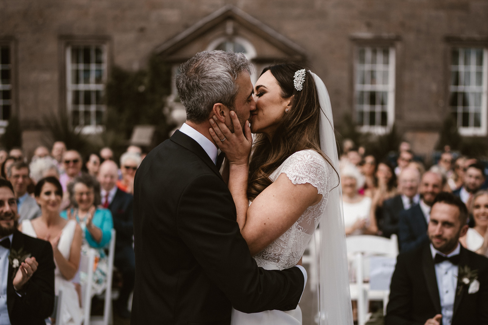 Bride and groom have their first kiss as husband and wife. Wedding pictures