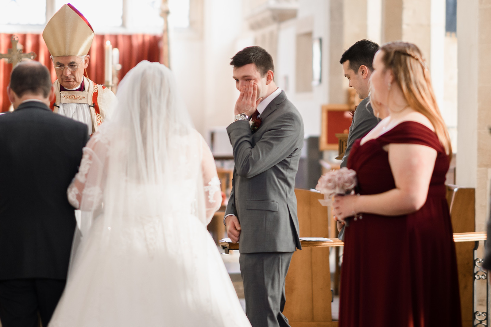 Groom wipes his tears away as his bride meets him at the end of the aisle| Cotswold Wedding Venue