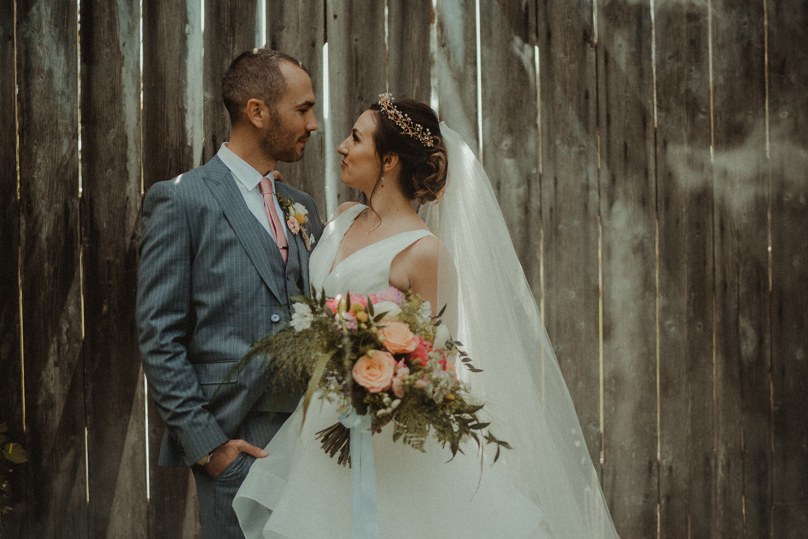 Bride and groom look into each others eyes  Wedding photo
