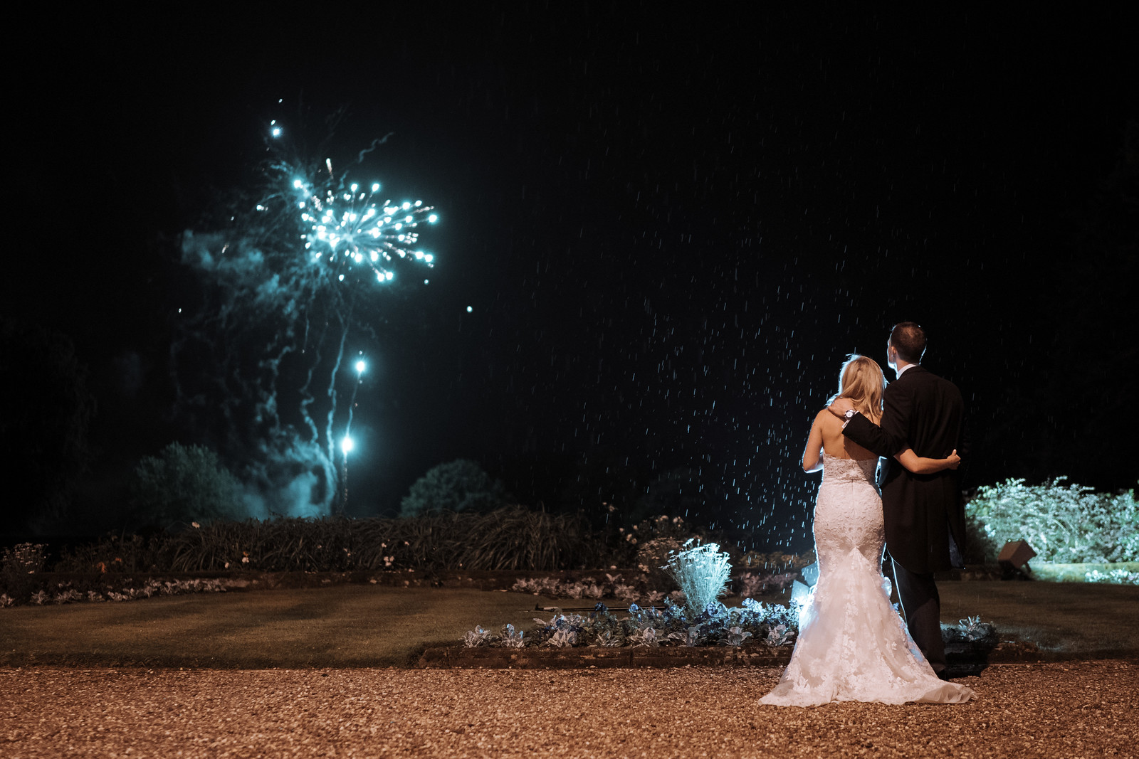 Bride and groom watch the fireworks.