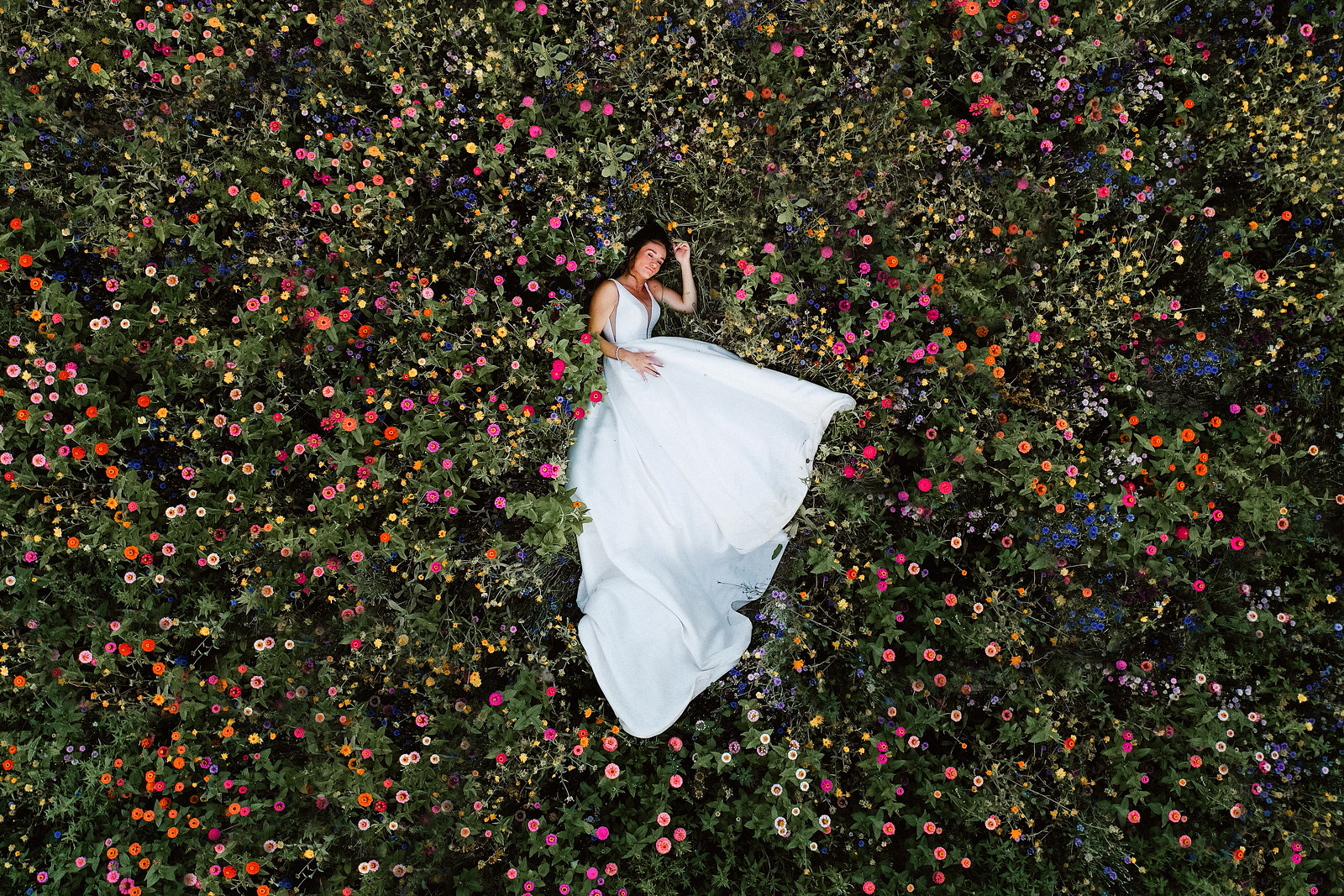 Bride lying in the middle of stunning greenery