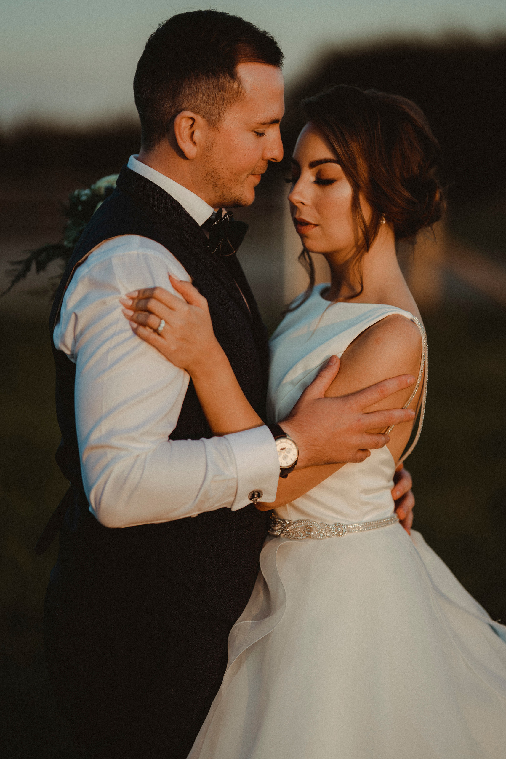 Bride and groom hold each other close