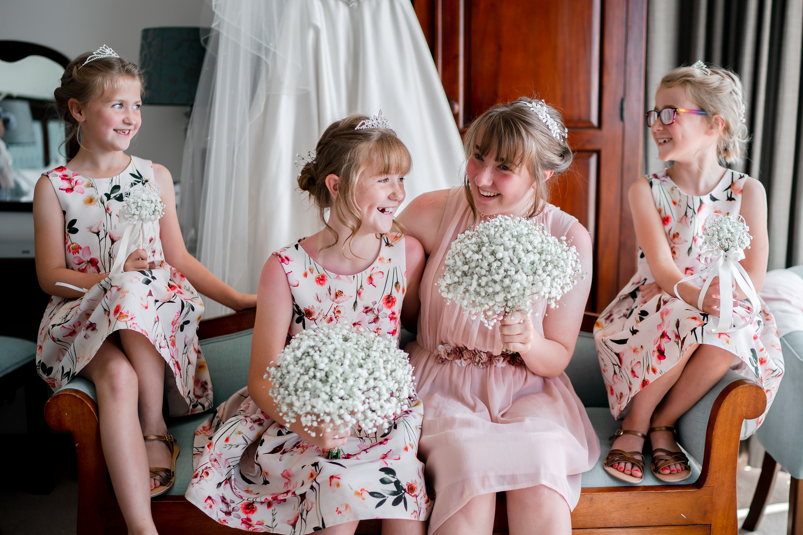 4 young bridesmaids laughing and smiling together