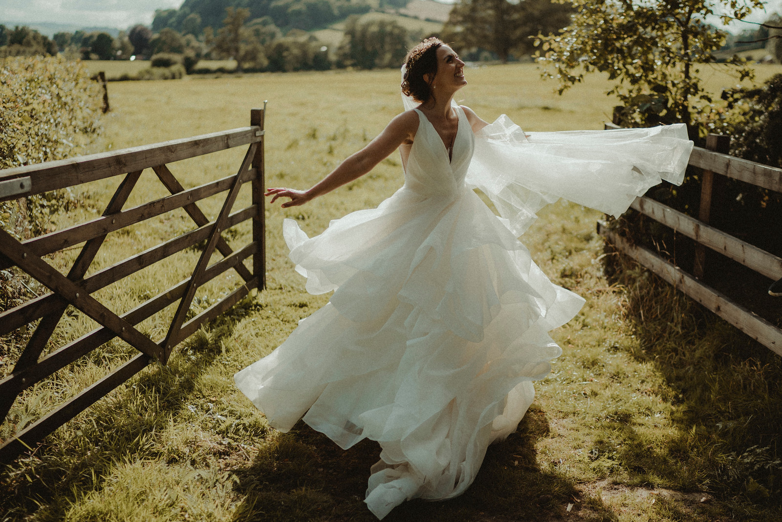 Bride dances in the middle of the scenery of her wedding venue  Wedding photo