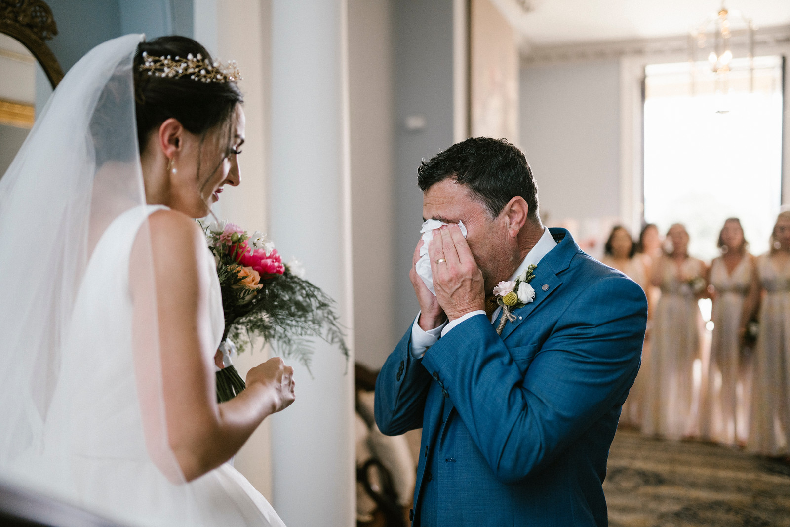 Father wipes away his tears after seeing his daughter in her dress for the first time  Wedding Photo