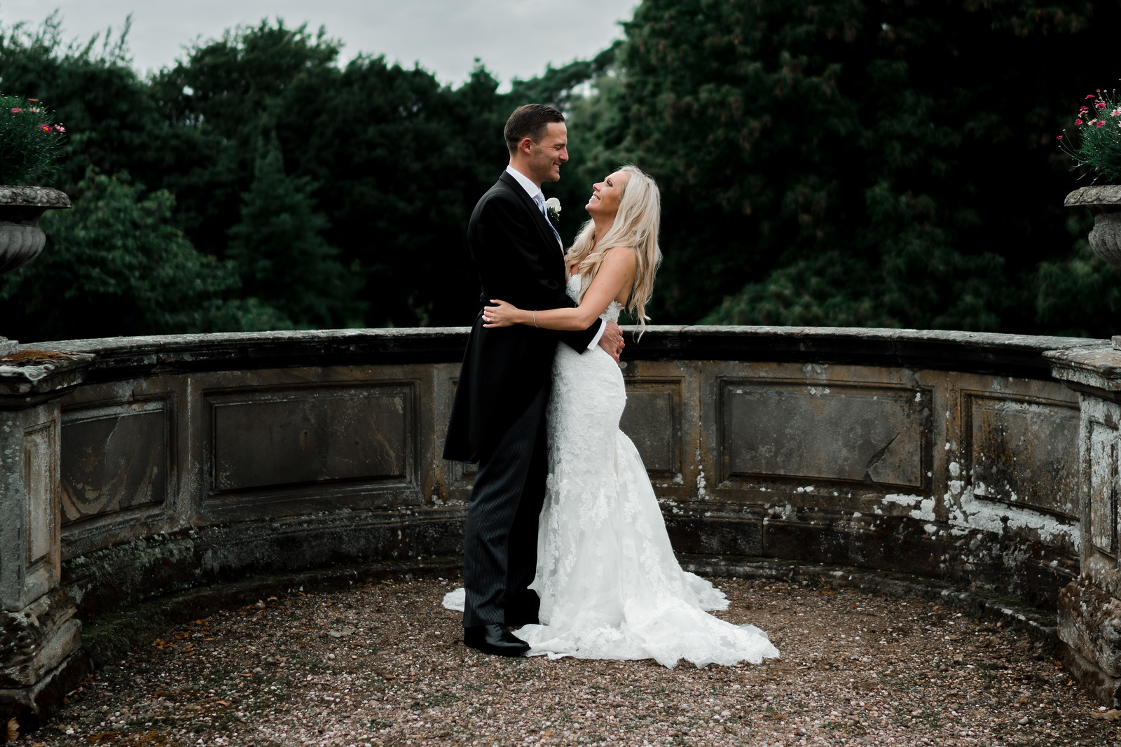 Bride and groom look at each other in their elegant wedding venue