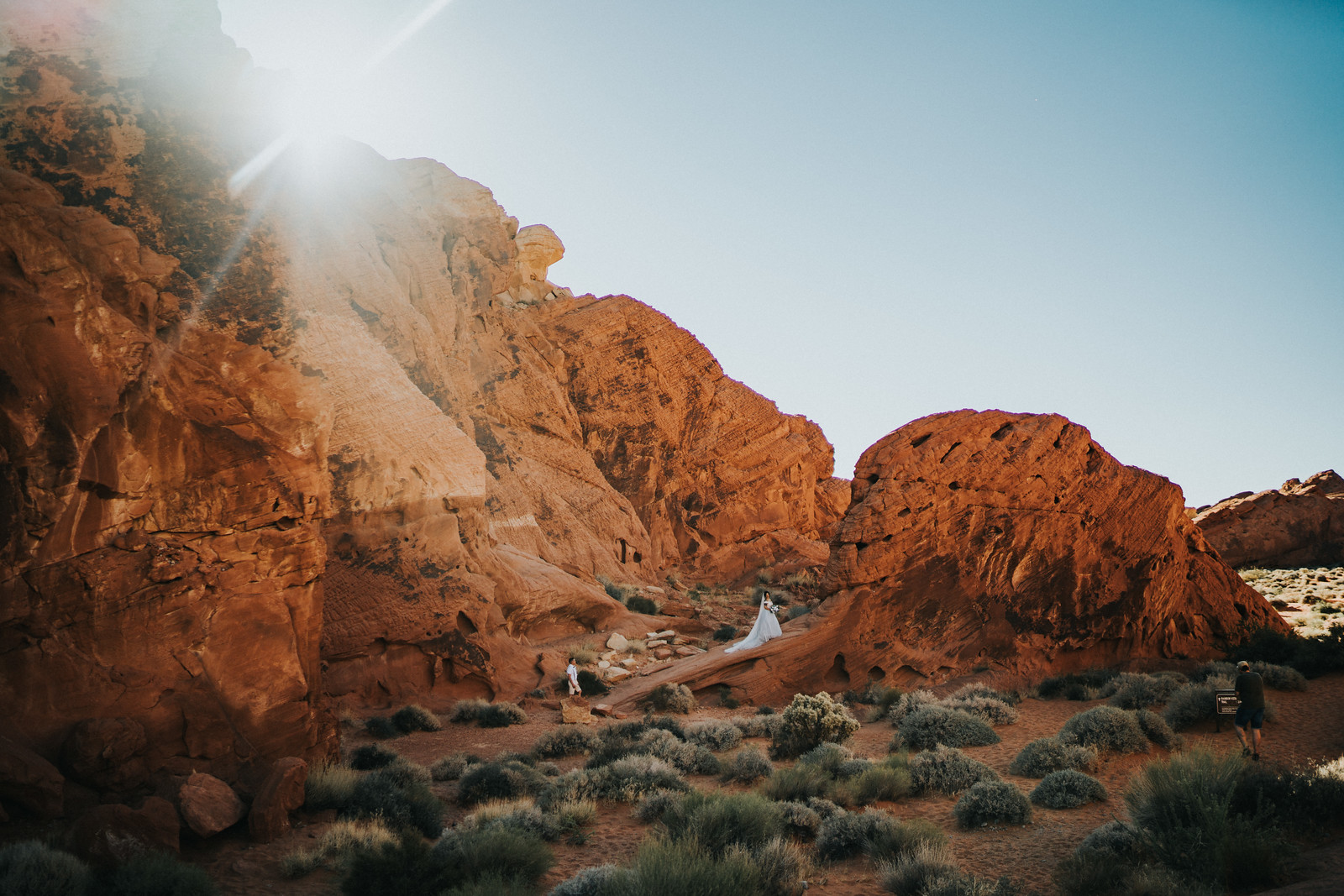 The couple walk around the mountain rock of their venue