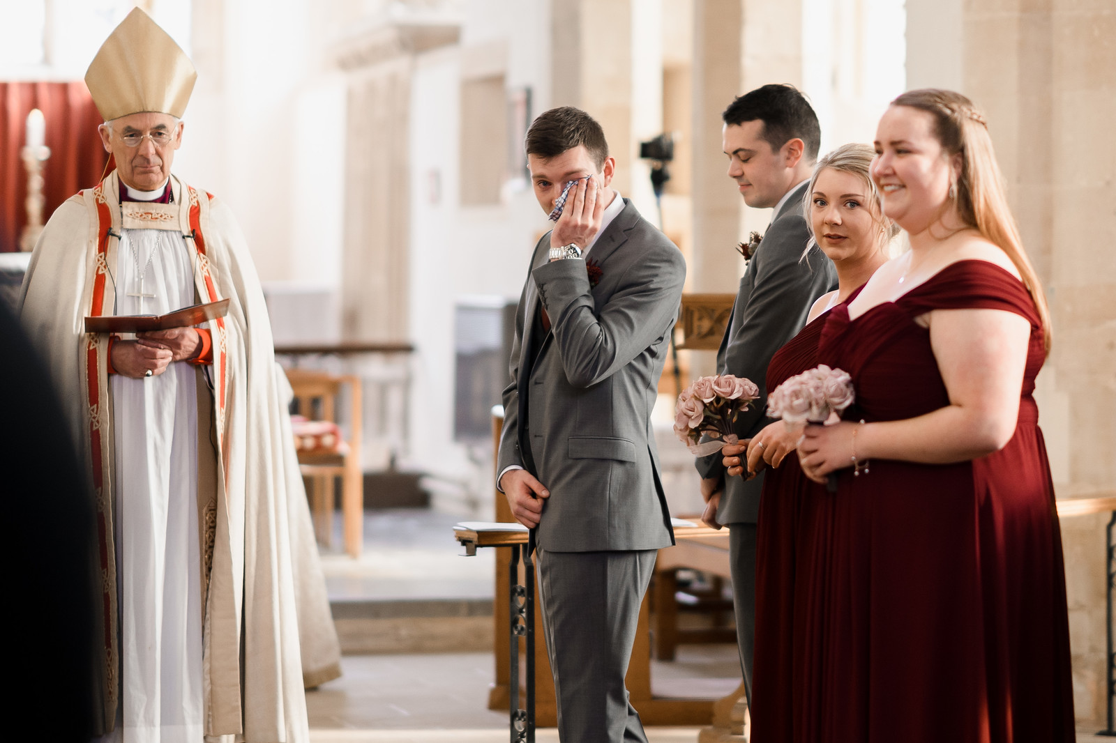 Groom wipes his tears away as his bride walks down the aisle| Cotswold Wedding Venue