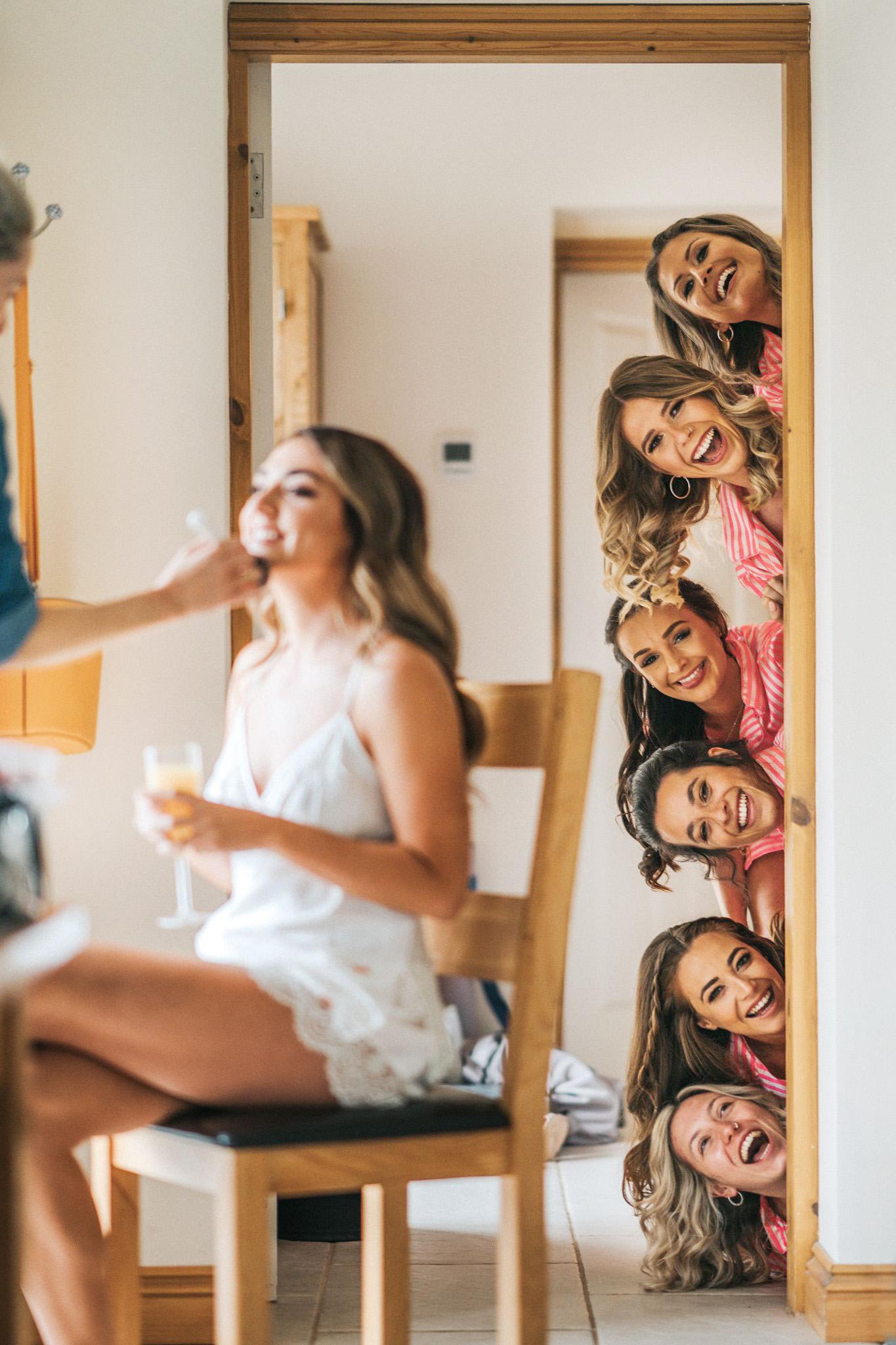 A fun bridesmaids wedding photo
