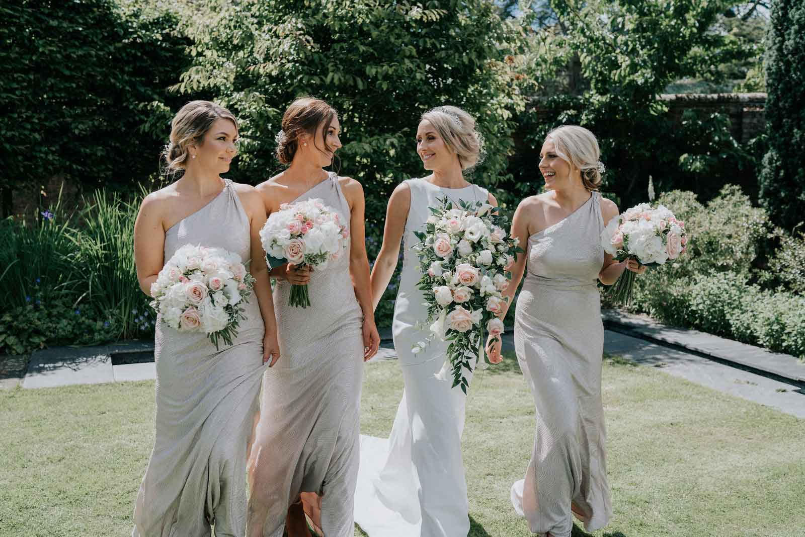 bridesmaids show their happiness for the bride