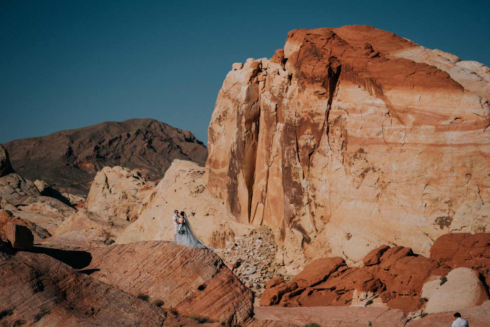 Couple on top of their mountain rock in las vegas