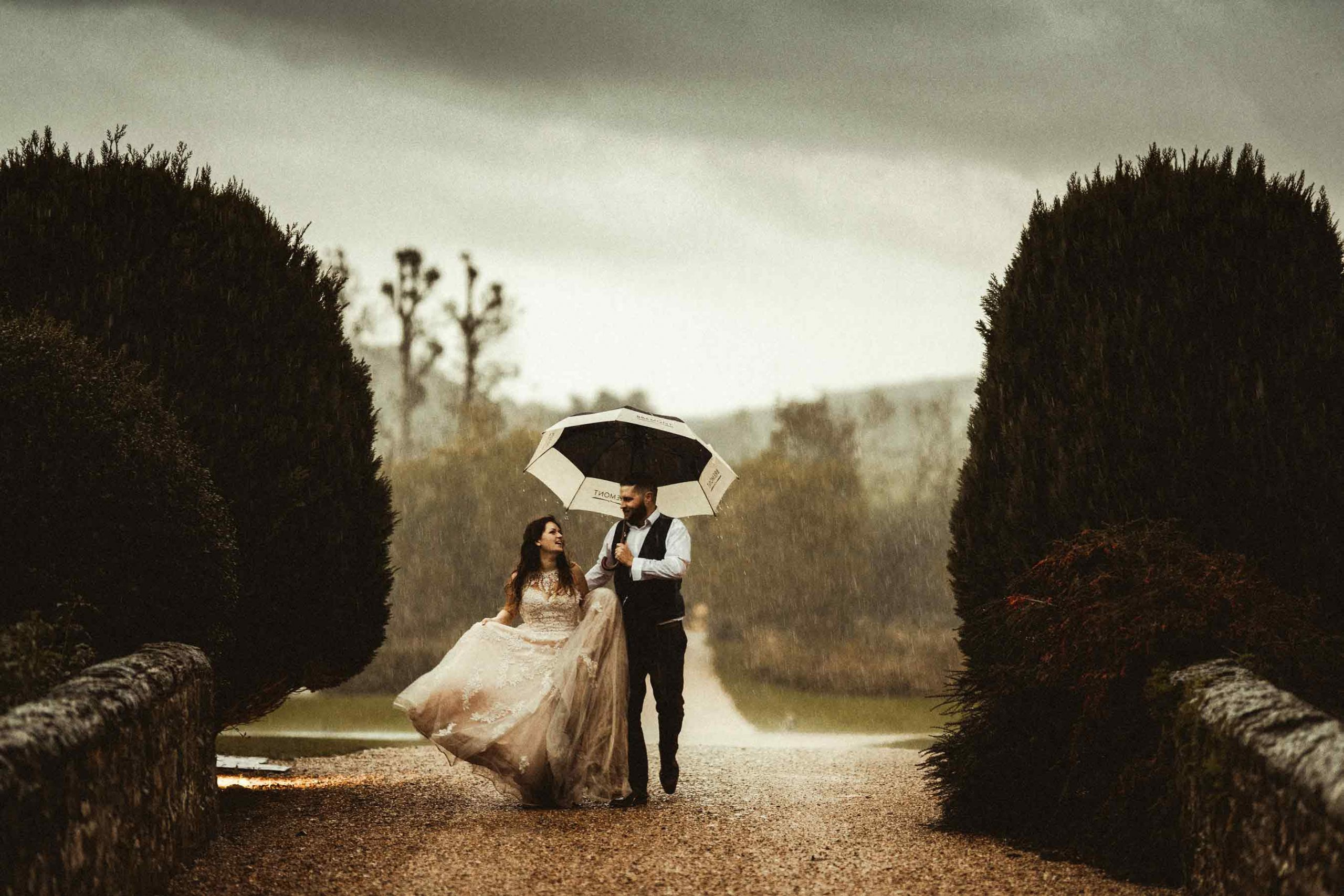 Bride and groom wedding photo in the rain