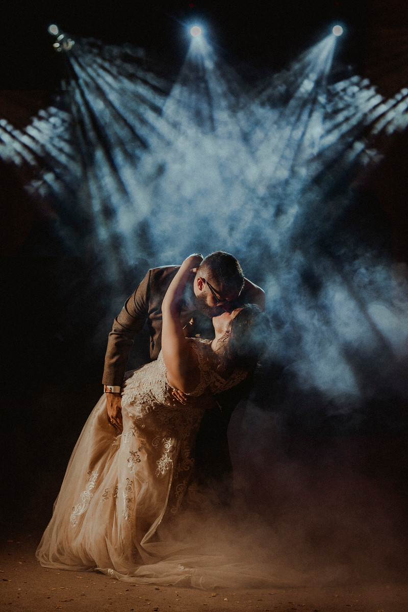 Bride and groom kiss as they have their first dance as husband and wife