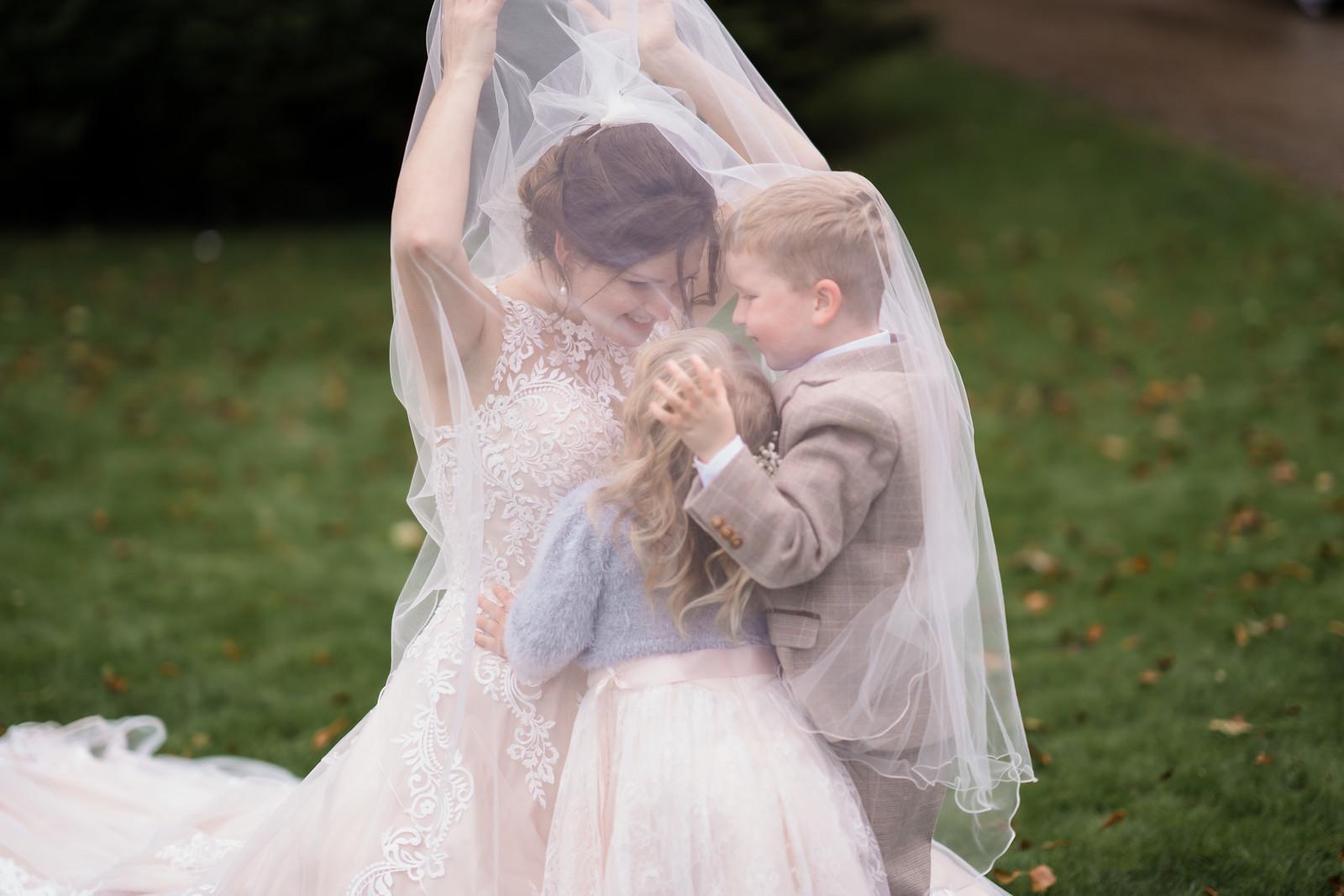Bride and her children wedding photo