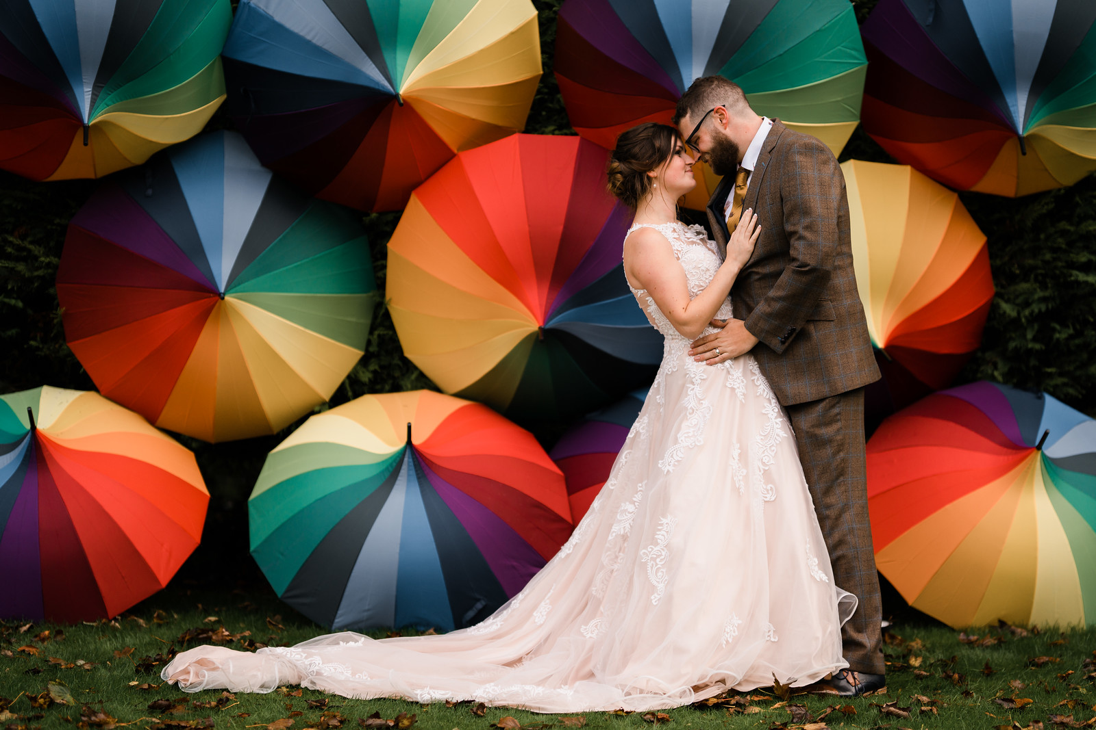 Bride and groom wedding photo with a colourful umbrella background