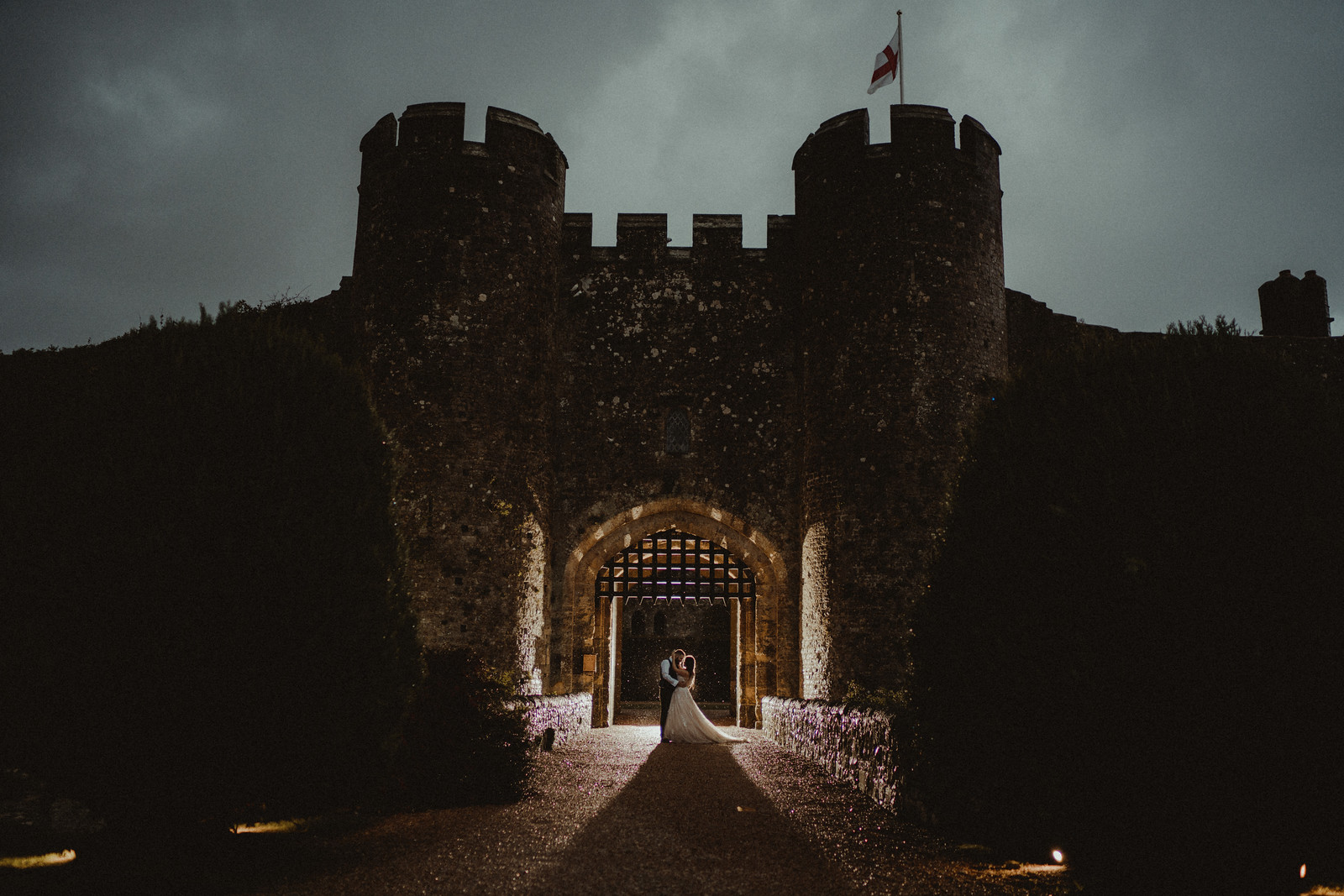 Bride and groom wedding photo with light projecting on the castle