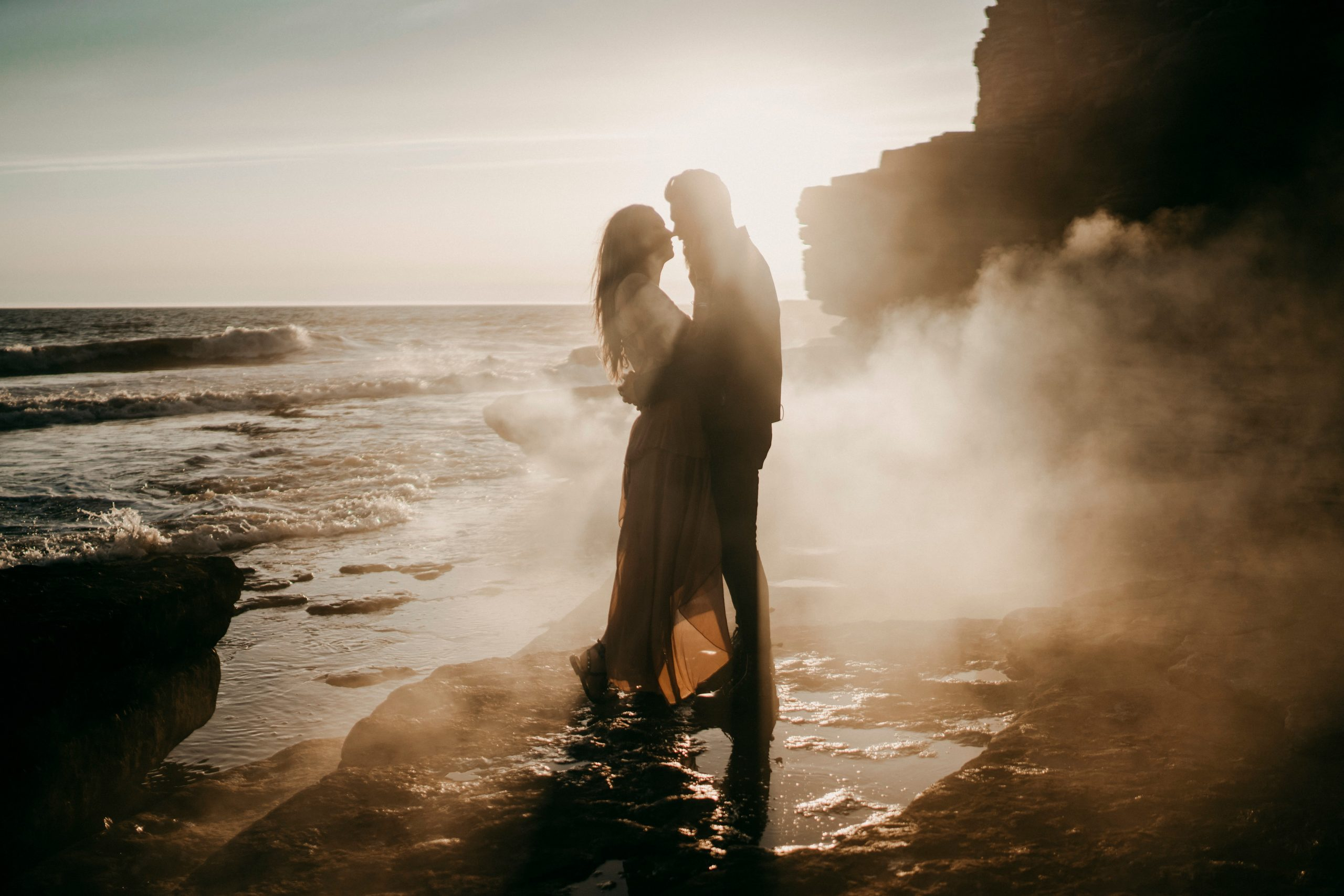 A sunset beach location image of a husband and wife to be