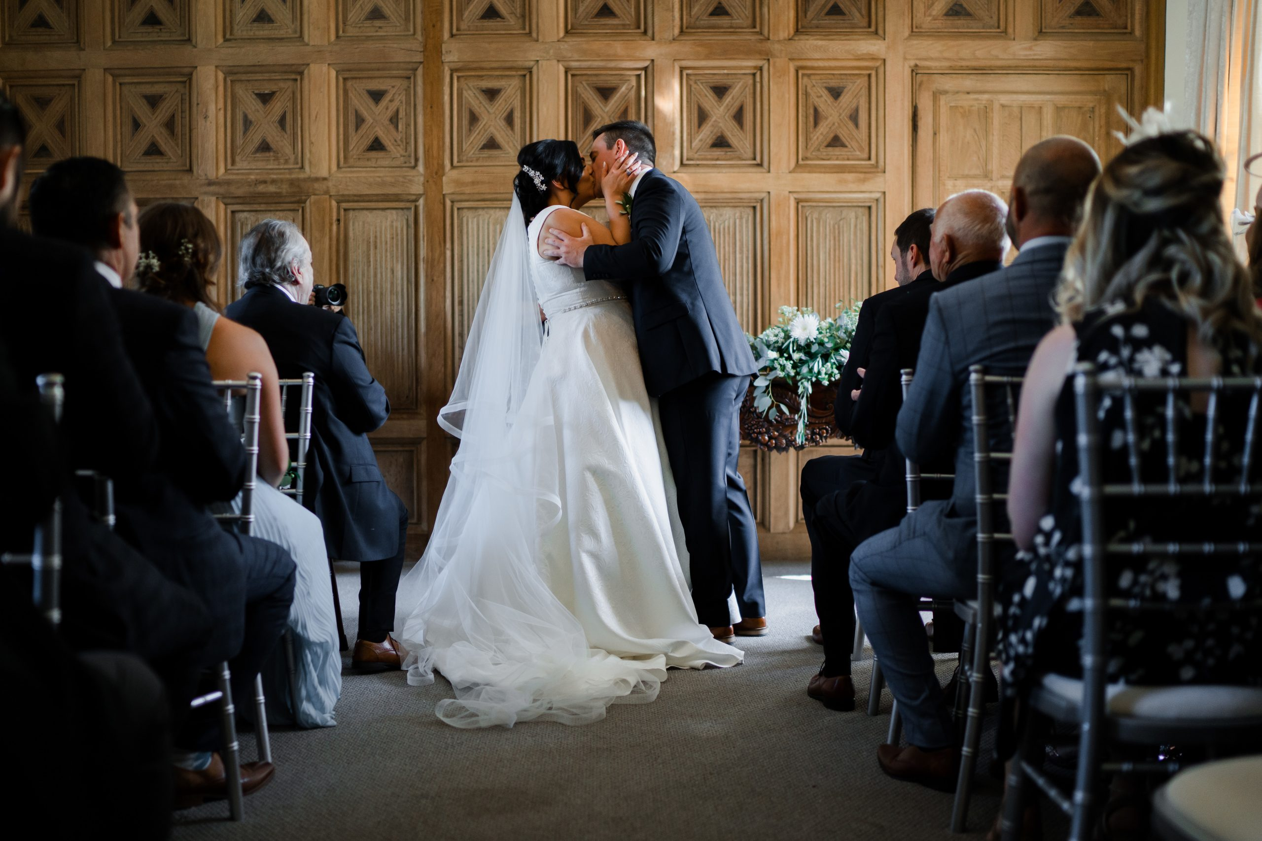 Bride and groom first kiss wedding photo - South Wales wedding photography