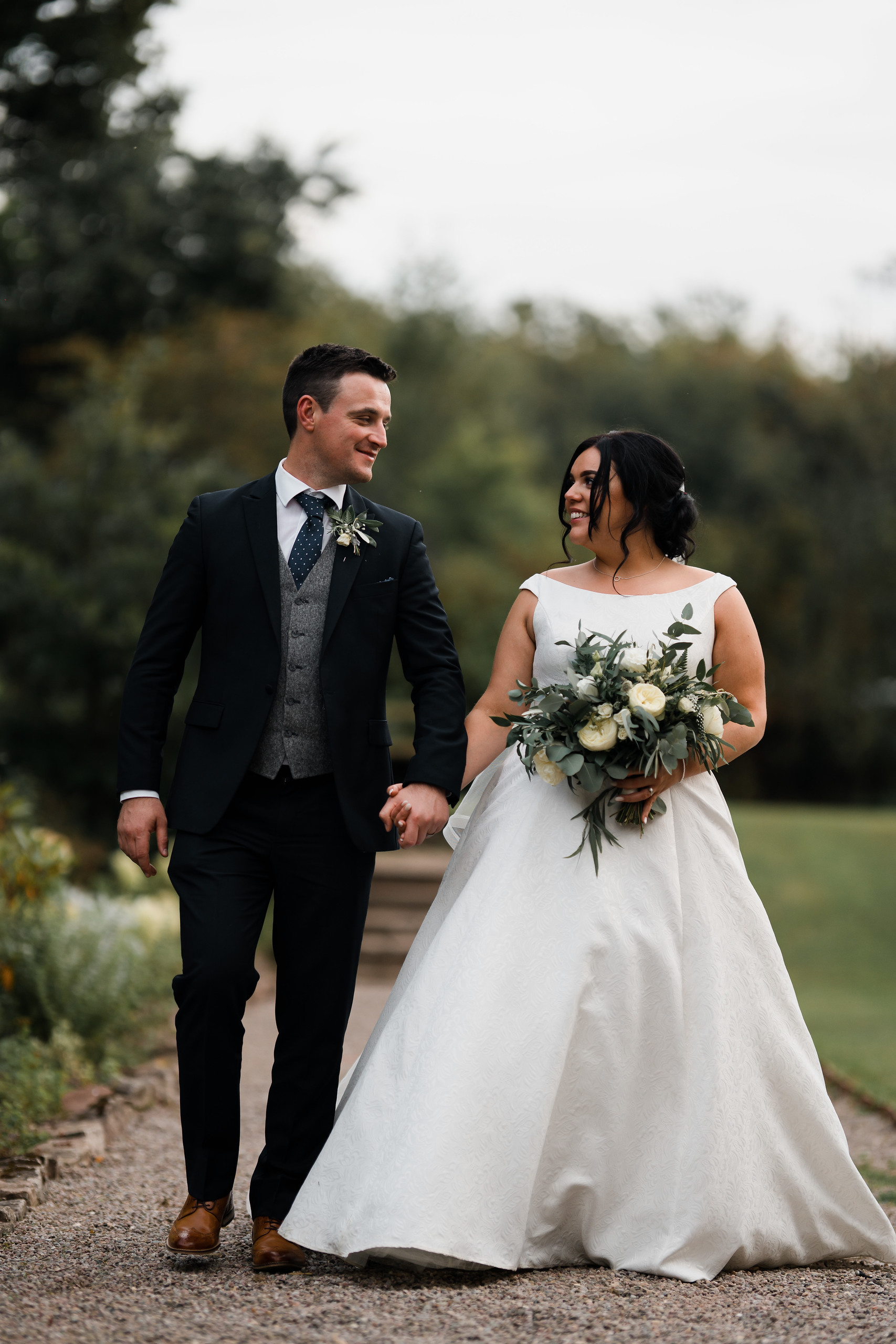 Bride and groom wedding photo full of smiles - Wedding photographers South Wales