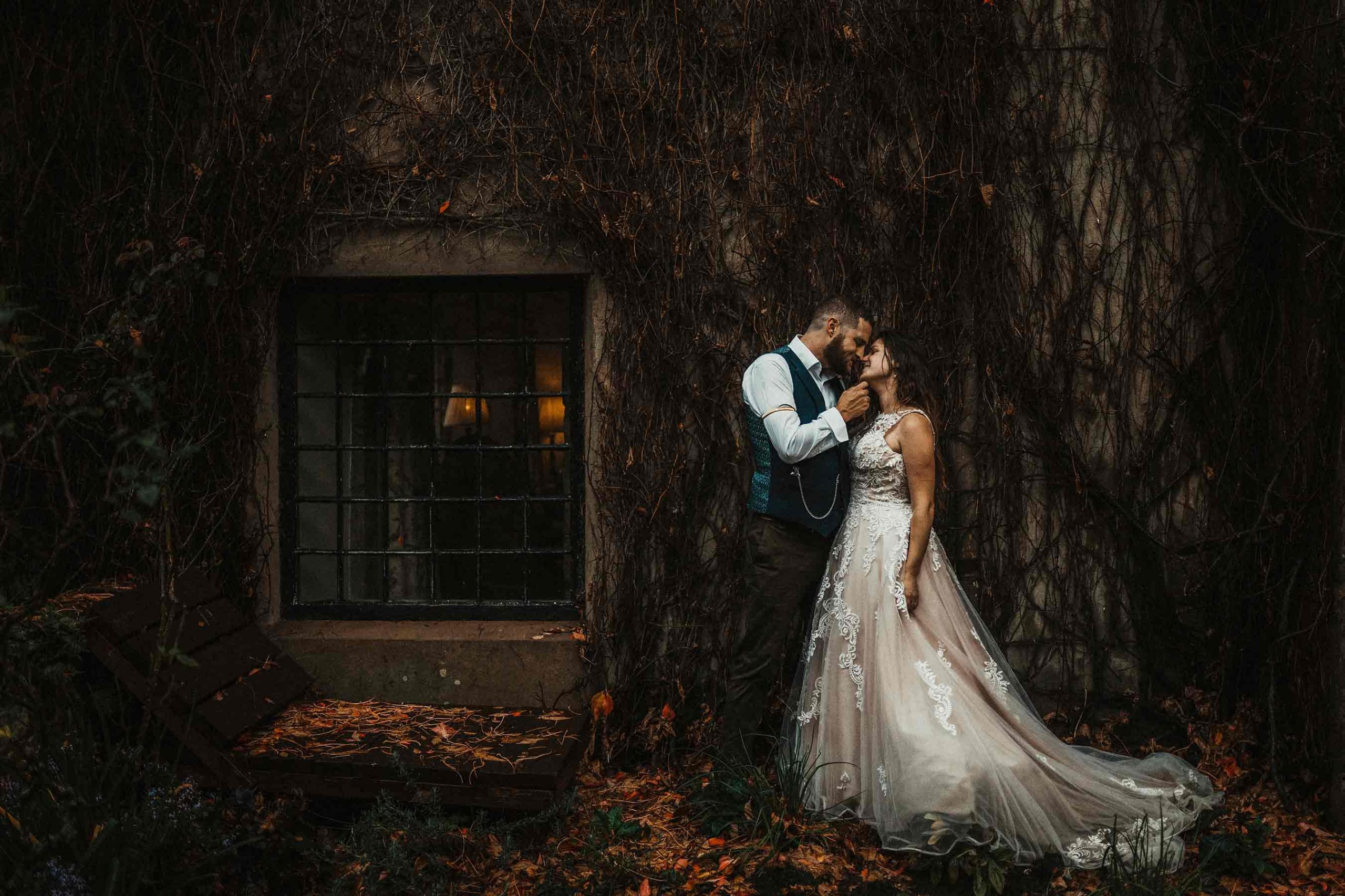 Bride and groom with a rustic background - wedding photographer and videographer Chepstow