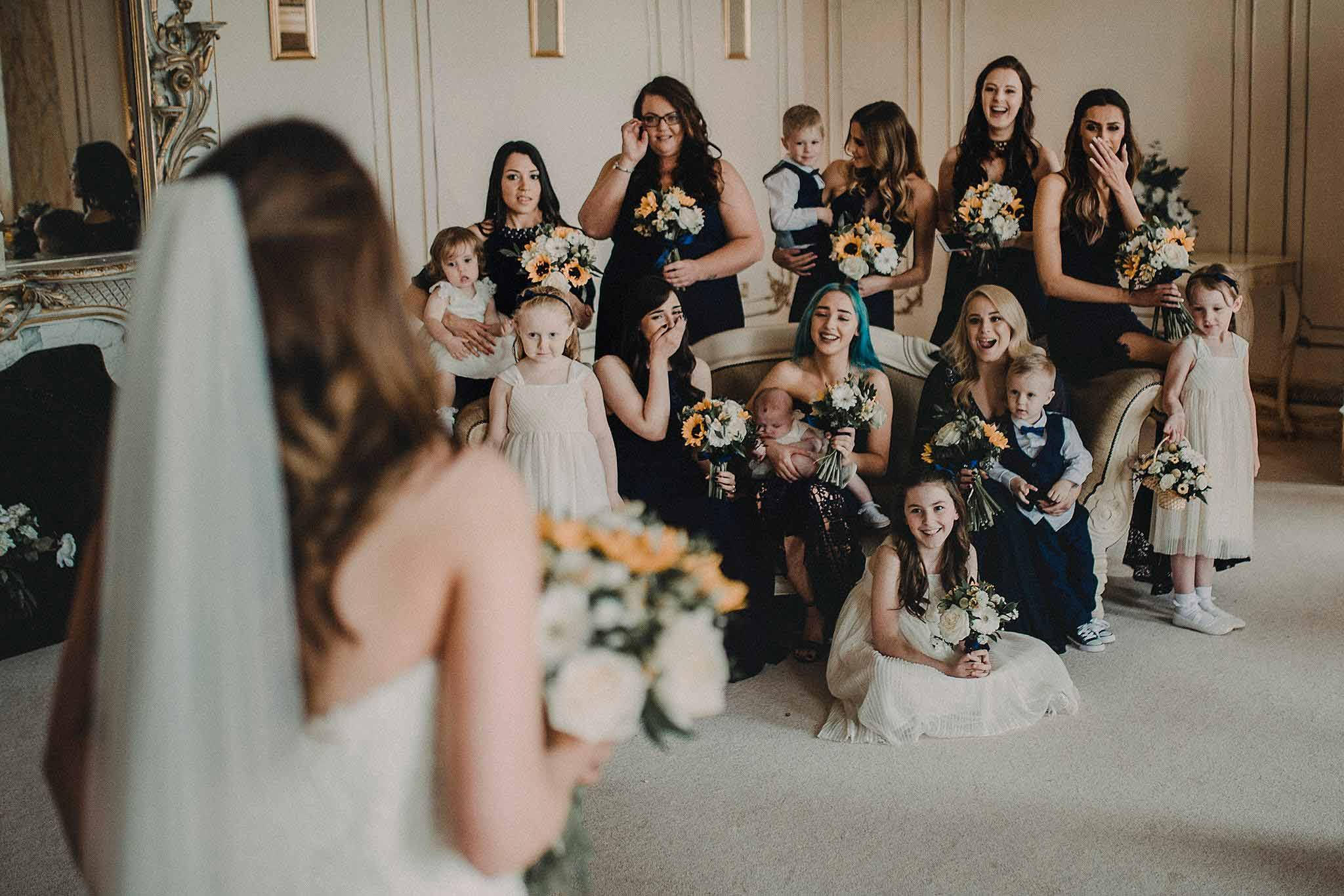 Bridesmaids reaction to the bride wedding photo - Gosfield Hall Wedding
