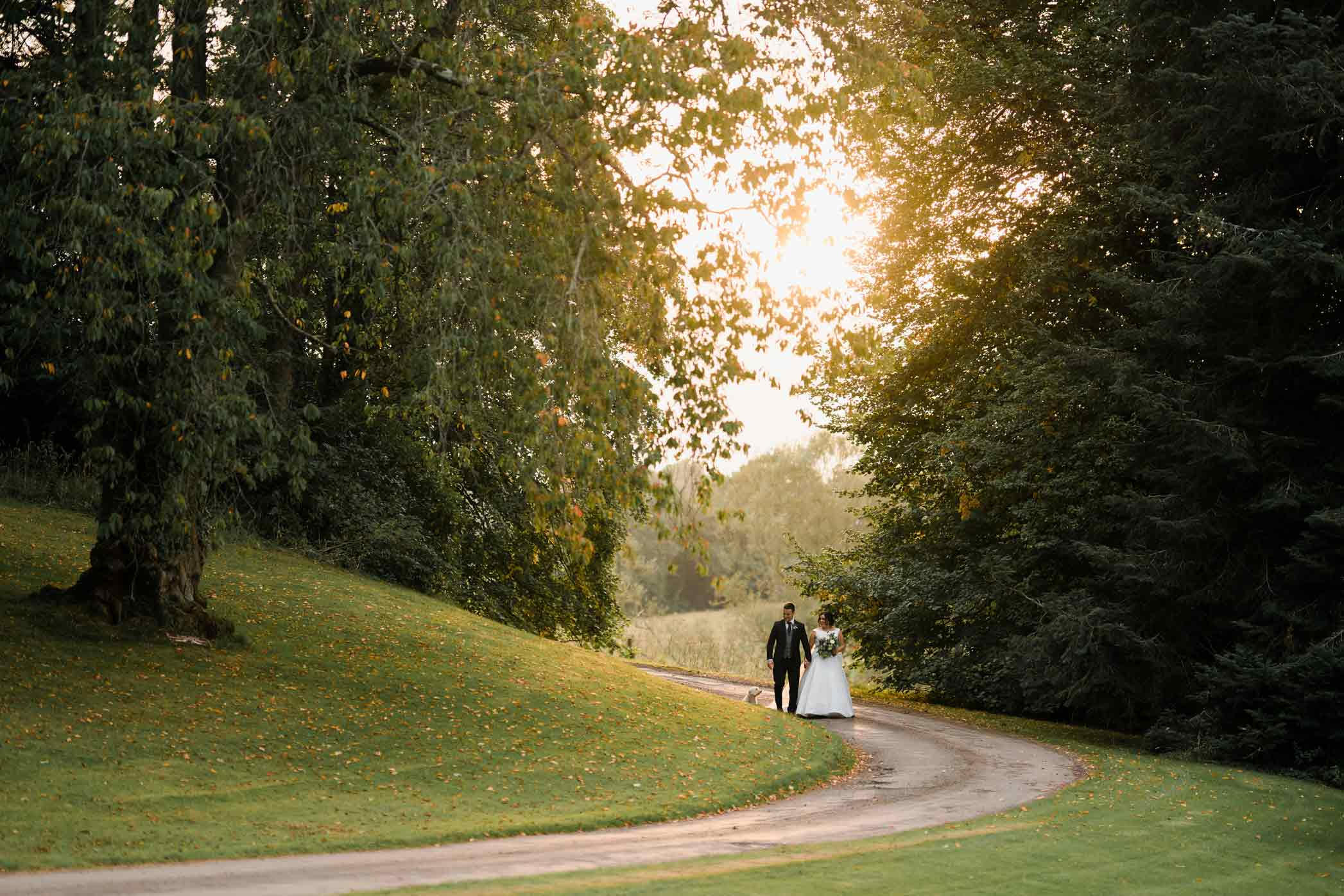 Sunlit wedding photo of bride and groom - South Wales Wedding Photography