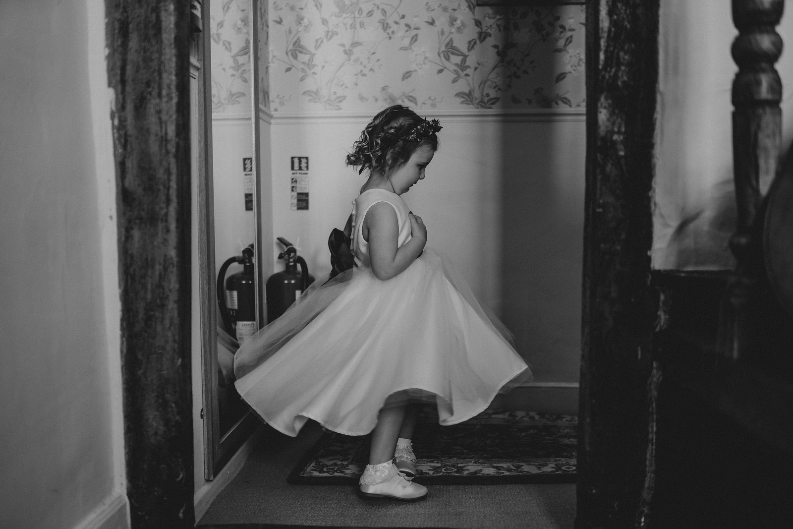 Young Childs looks in the mirror with her dress on for the wedding