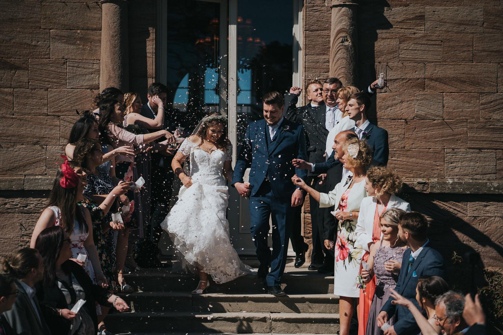 Bride and groom confetti photo - wedding photographers Northumberland