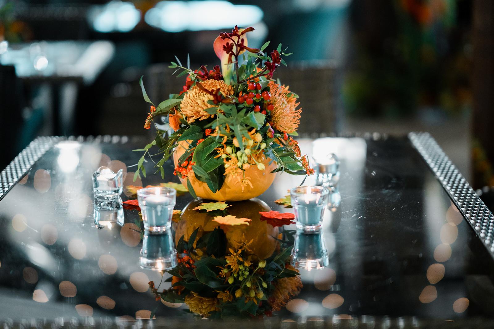 Autumn theme wedding centrepiece design