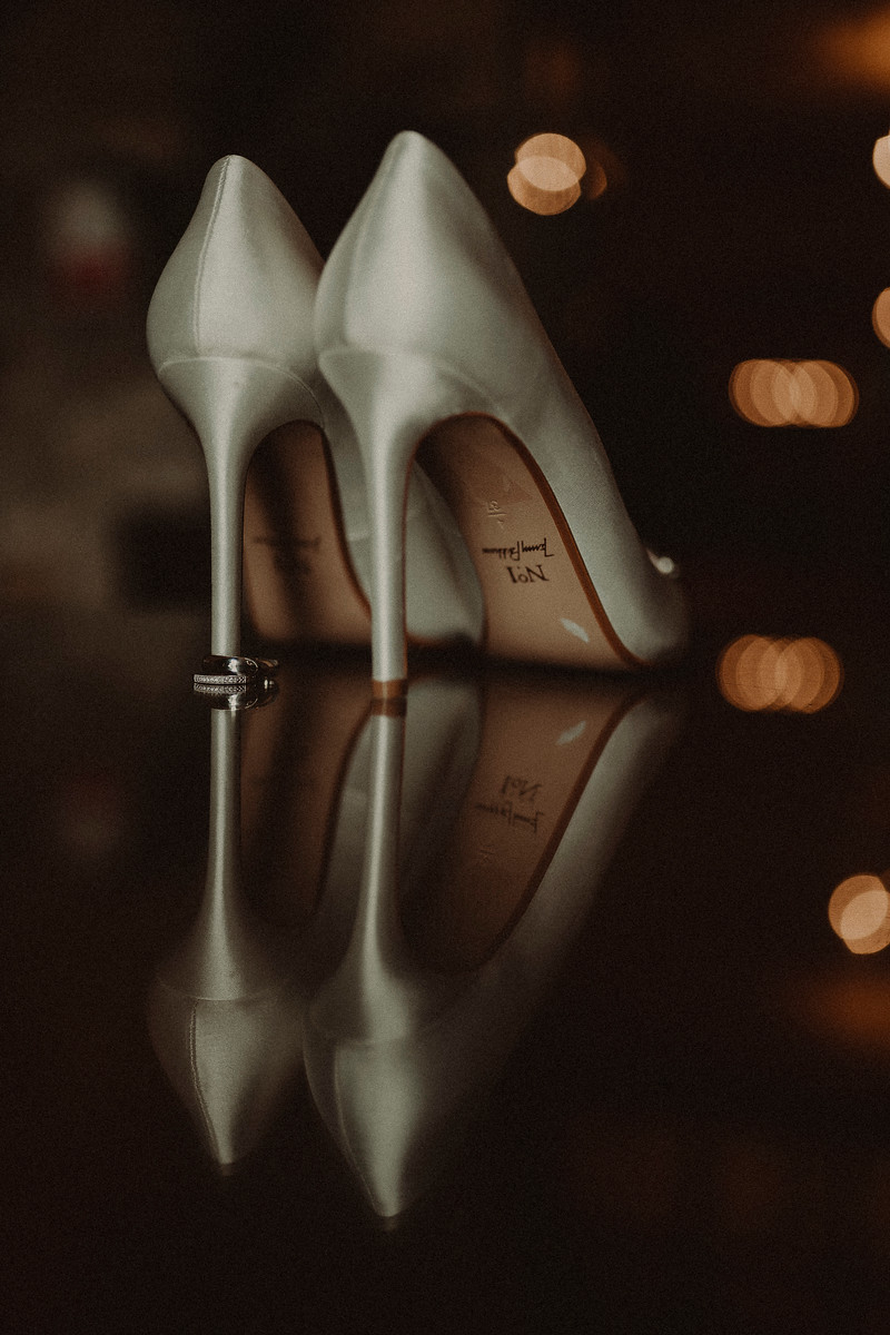 Rings and wedding shoes wedding photo