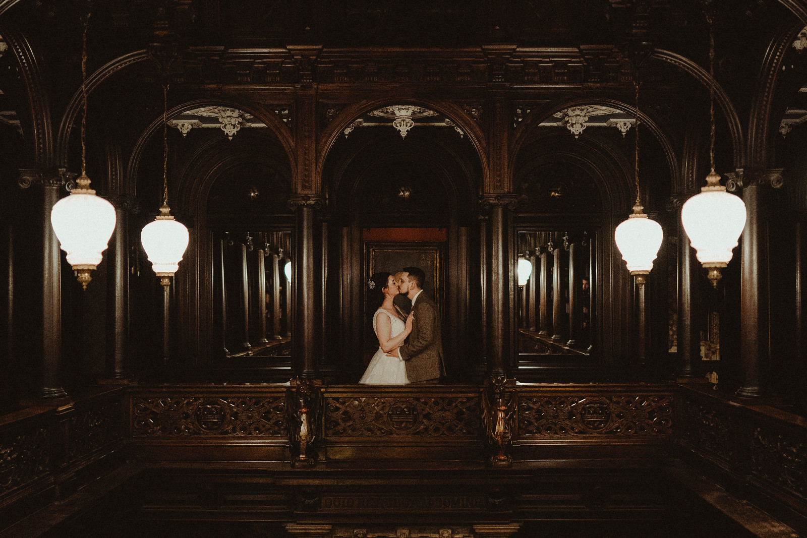 Bride and groom kiss in their vintage wedding venue| Wedding photographers