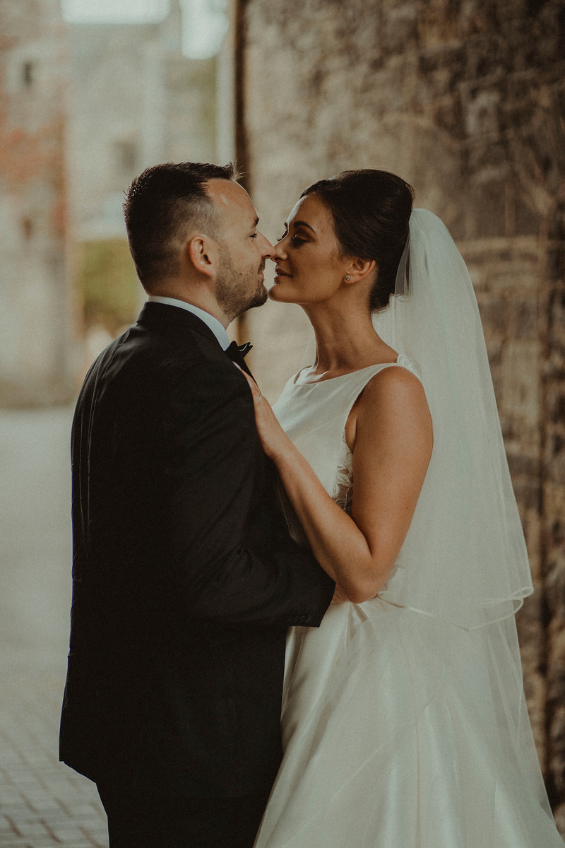 Bride and groom look at each other| Wedding photographer and videographer