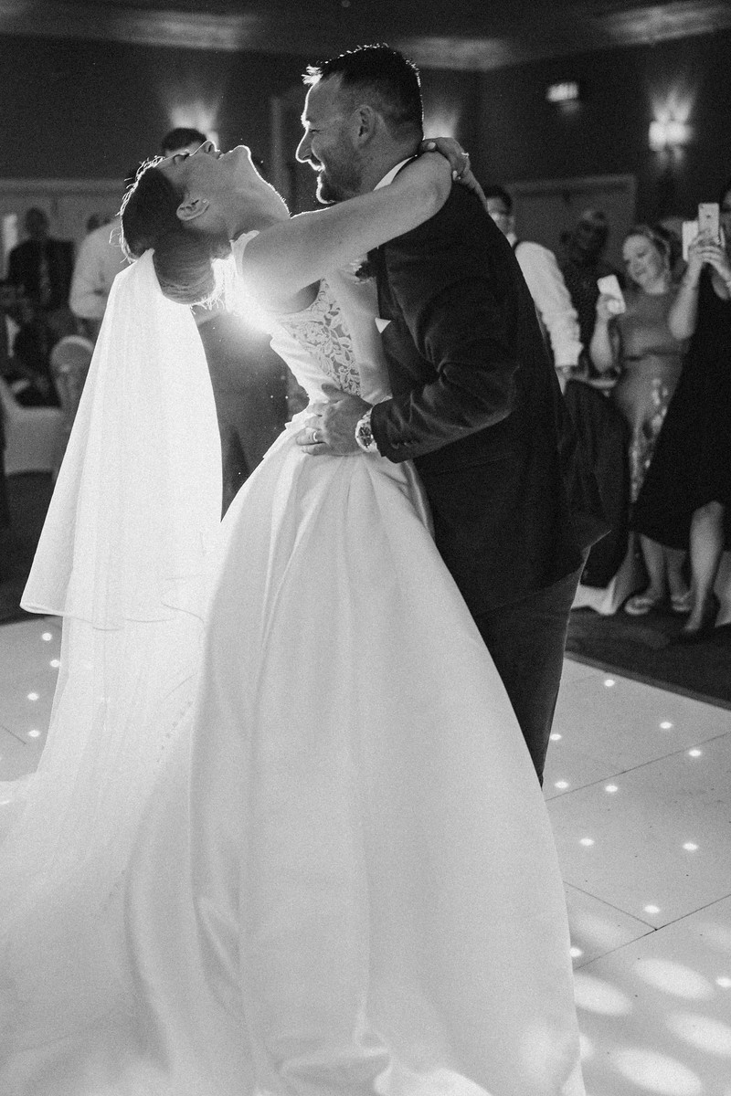 Bride and groom dance and laugh| Wedding photography and videography