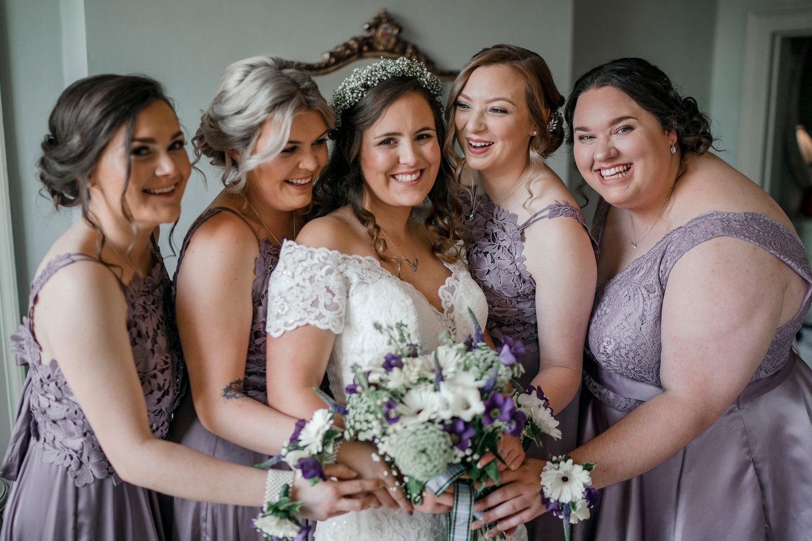 Bride and bridesmaids full of smiles - wedding photography Northumberland
